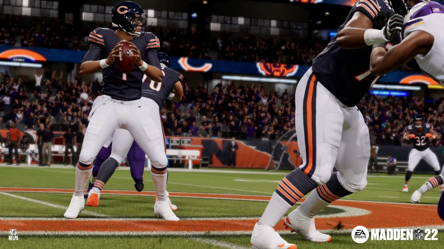 Nick Foles of the Chicago Bears standing in the pocket, looking for a receiver as two linemen block defenders off-screen