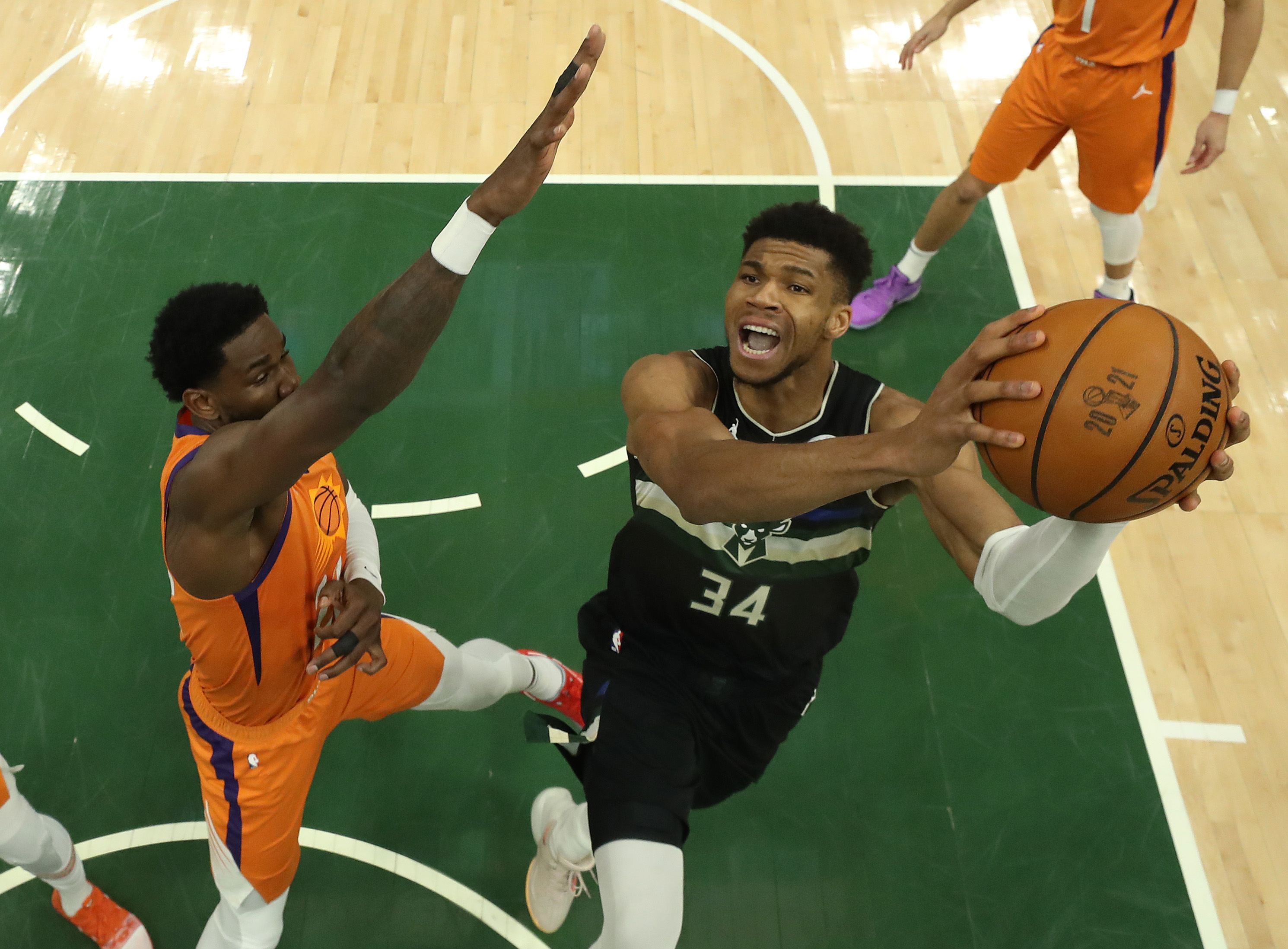 Giannis Antetokounmpo #34 of the Milwaukee Bucks goes up for a shot against Deandre Ayton #22 of the Phoenix Suns during the second half in Game Six of the NBA Finals at Fiserv Forum on July 20, 2021 in Milwaukee, Wisconsin.