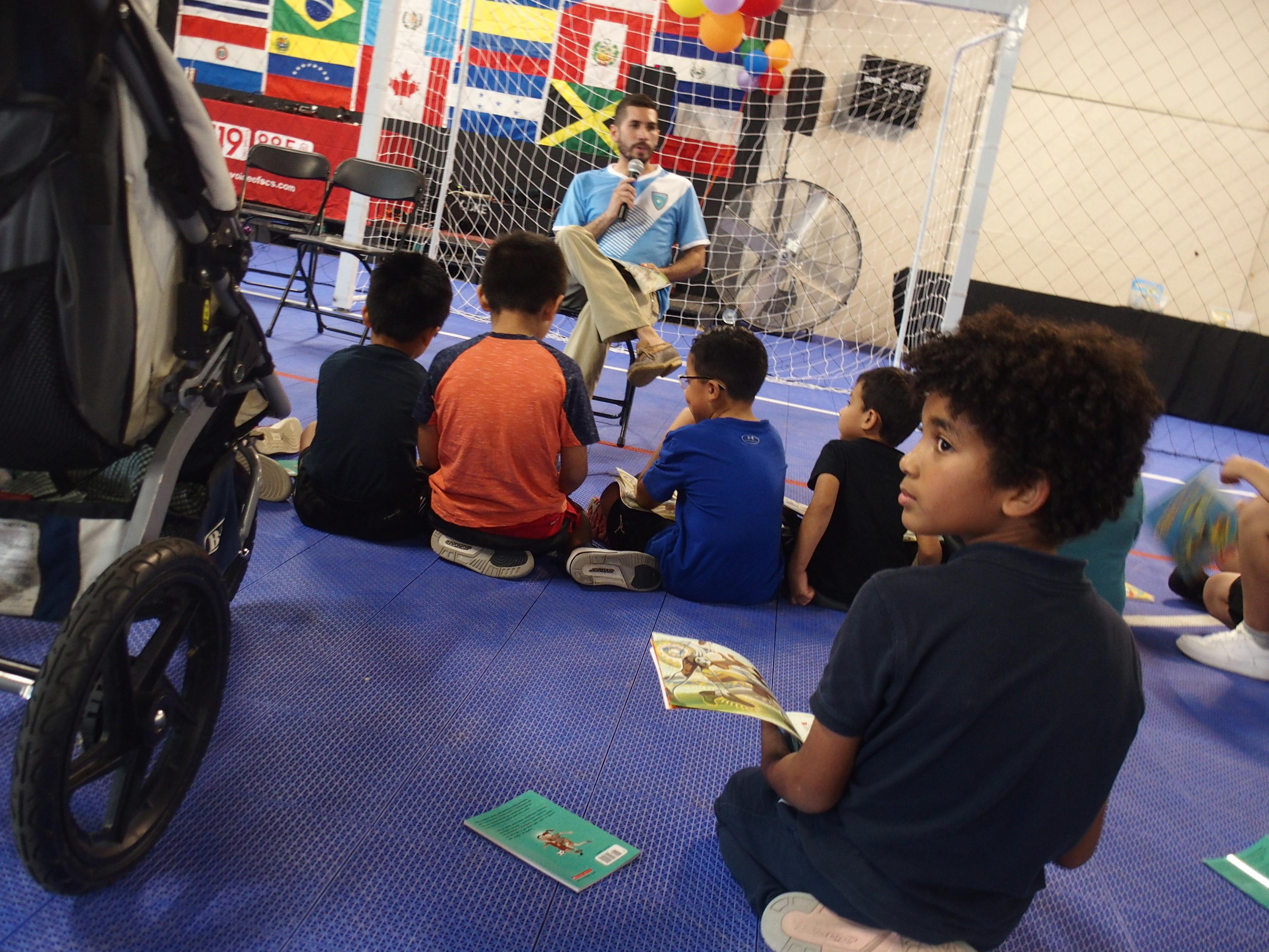 Students listen to a member of the Memphis 901 FC during a Shelby County Schools Hispanic Heritage Month reading event in 2019.
