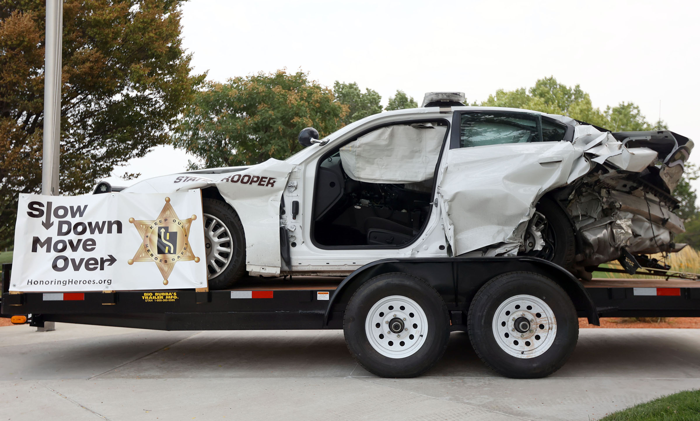 A wrecked Utah Highway Patrol vehicle is pictured outside of UHP headquarters in Taylorsville on Tuesday.