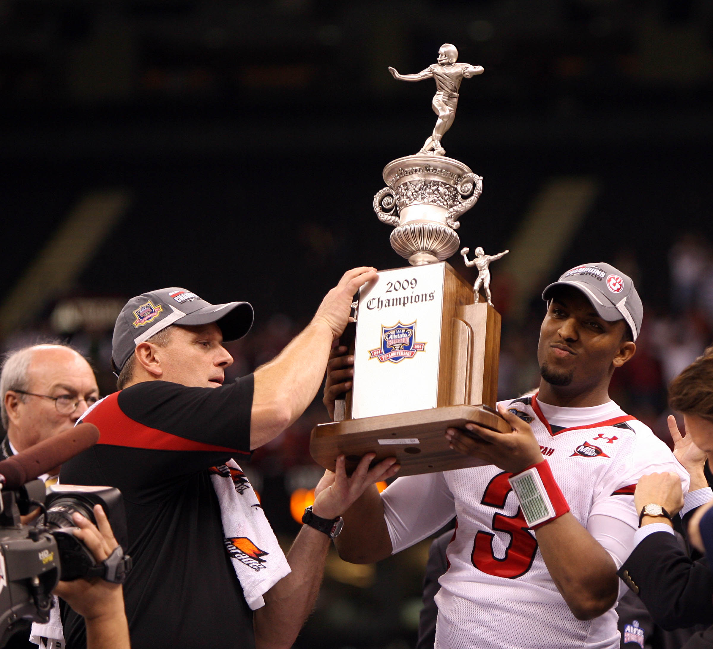 Utah head coach Kyle Whittingham holds the trophy with Utah quarterback Brian Johnson (3) after beating Alabama winning the 2009 Allstate Sugar Bowl, at the Superdome, in New Orleans, LA. Friday Jan. 2, 2009. Photo by Jeffrey D. Allred/Deseret News