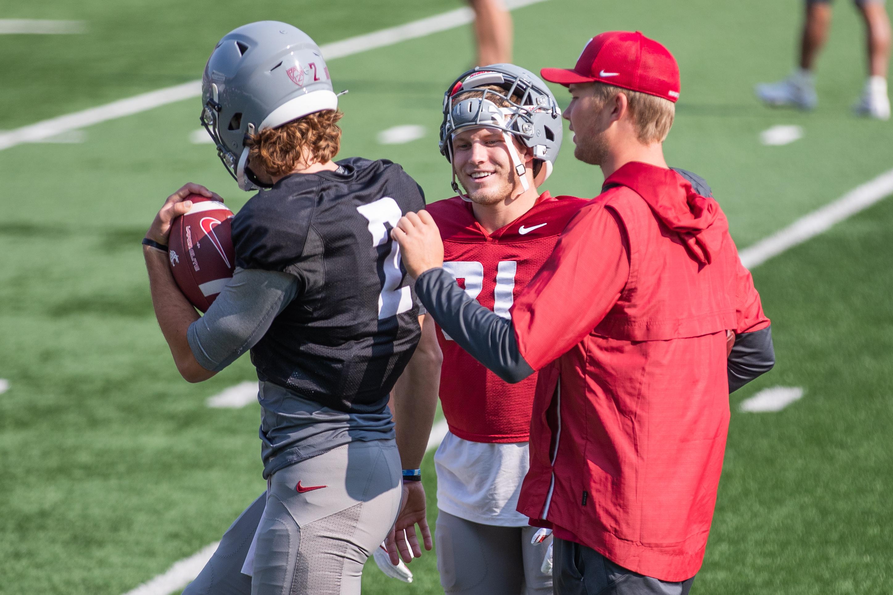 Washington State University Football Fall Practice 12 - Cammon Cooper (2) and Max Borghi (21)
