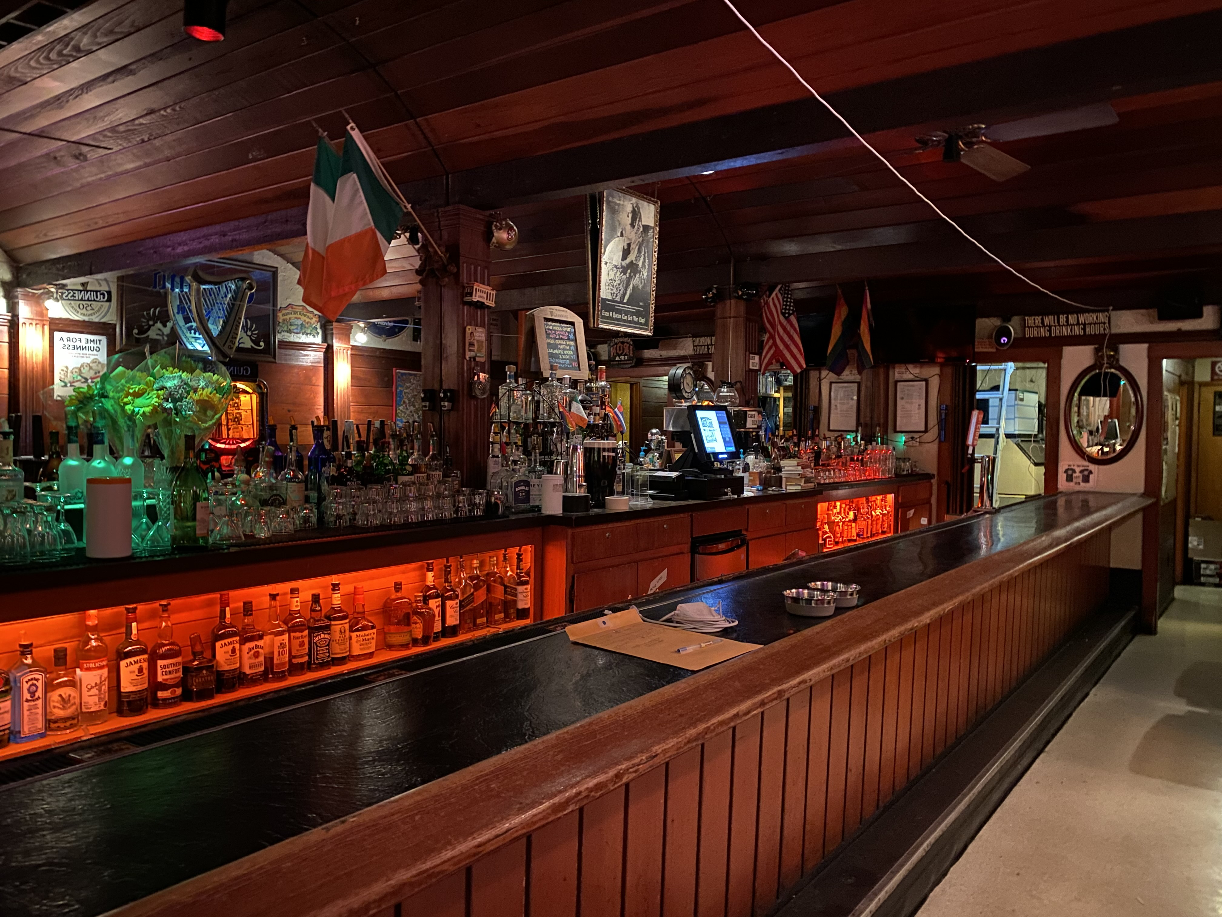 The wooden bar and backbar at Last Call Bar in the Castro