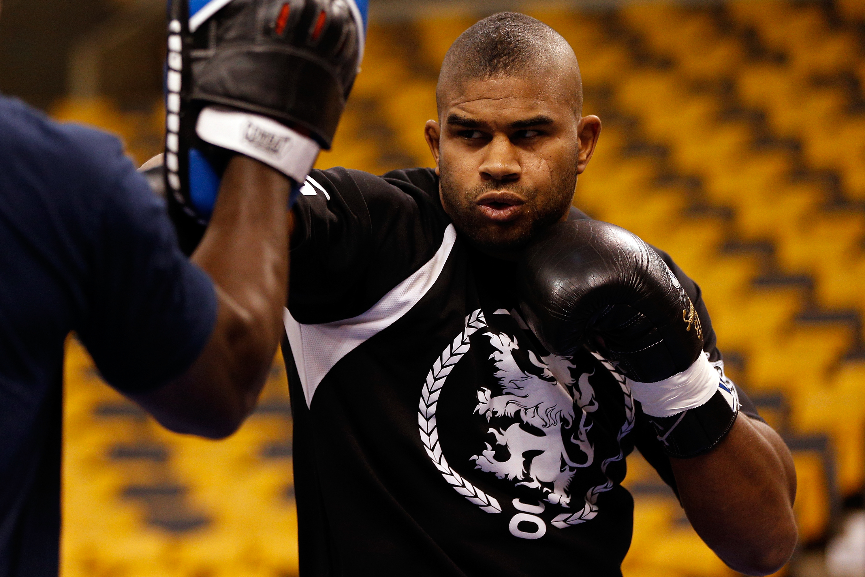 Alistair Overeem hits pads at an open workout ahead of his 2013 bout against Travis Brown.