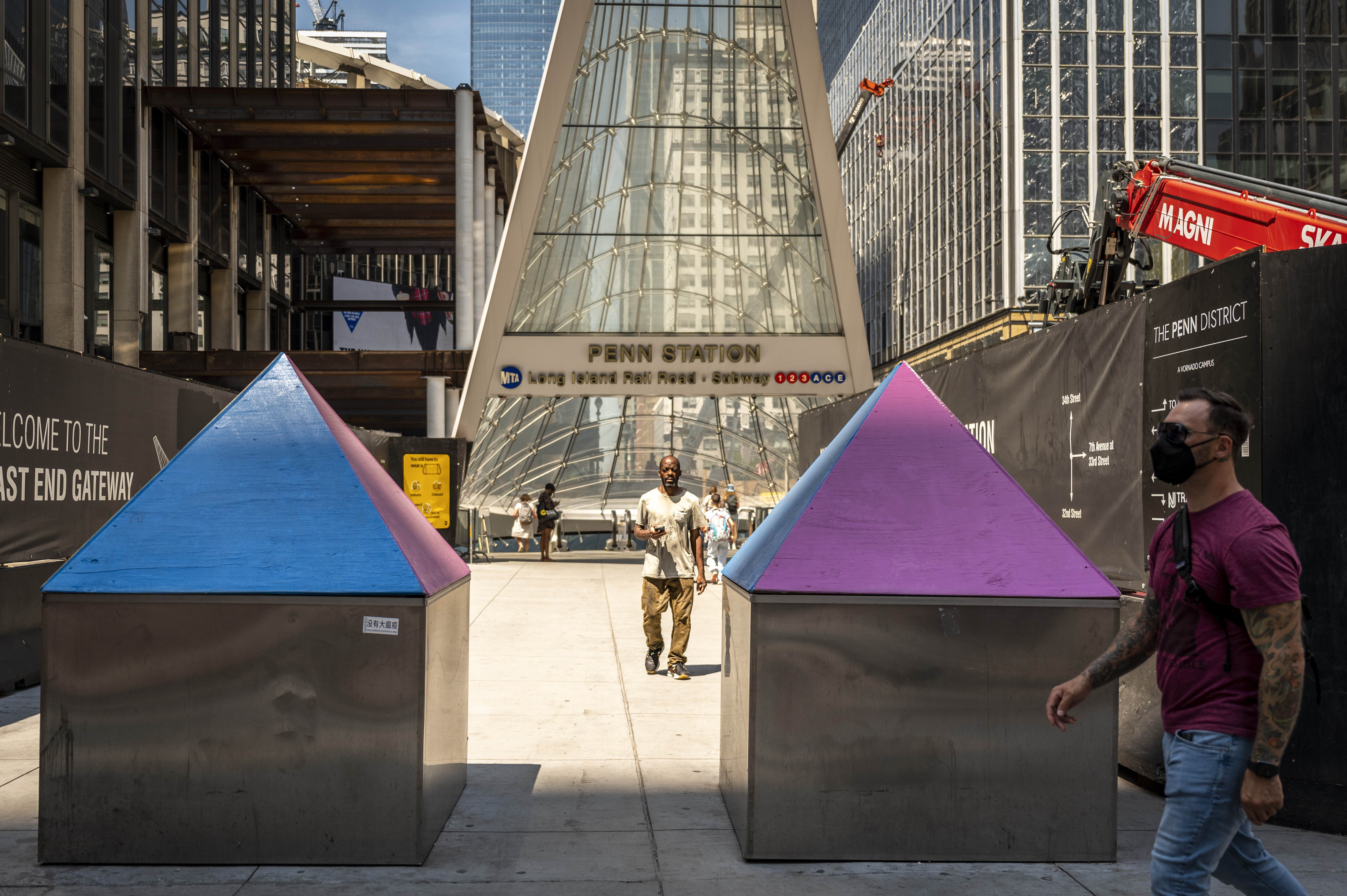 The colorful pyramids were recently added to the tops of bollards at the 33rd Street and 7th Avenue Penn Station to discourage lounging.