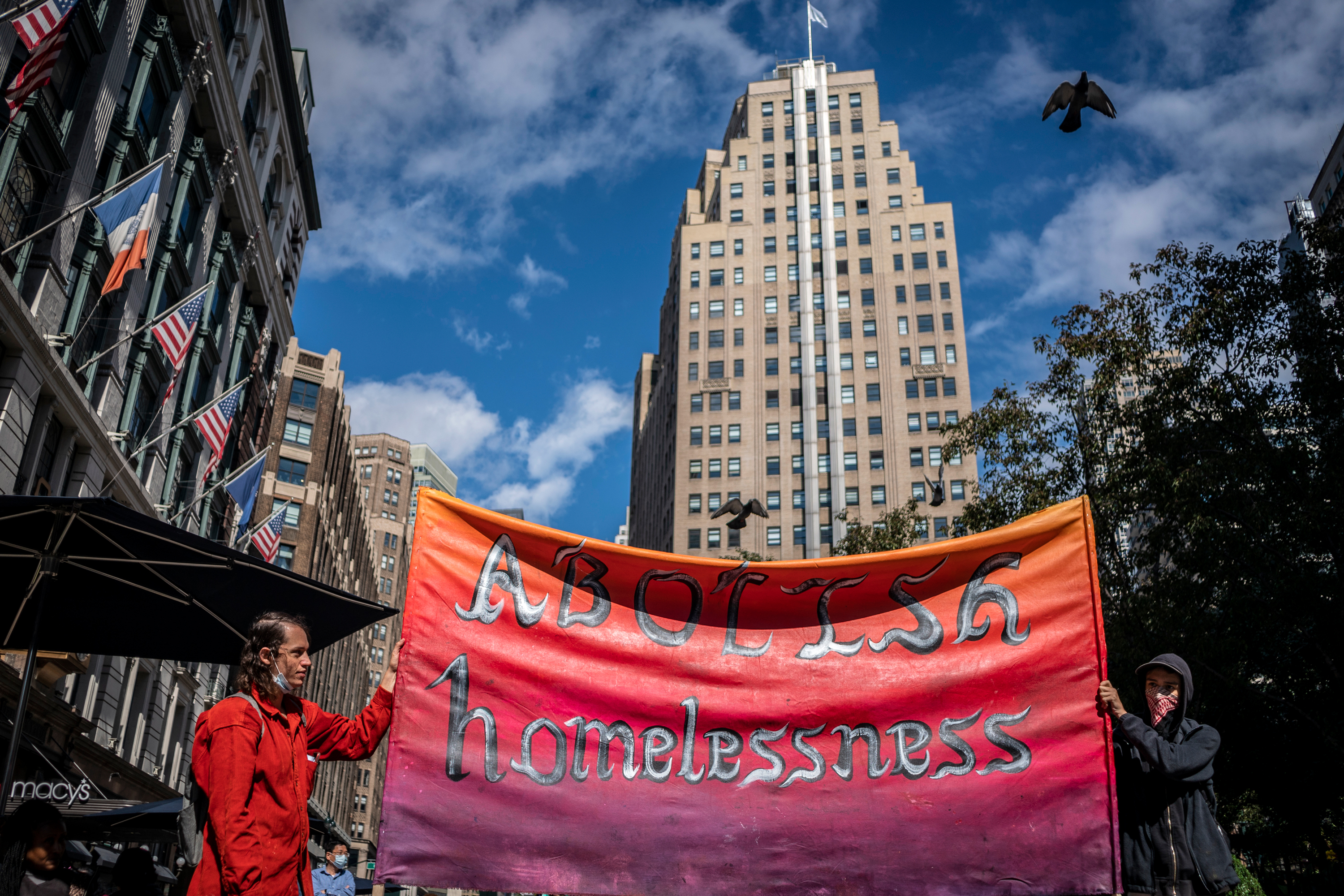 Advocates draw attention in Herald Square to increased struggles for homeless people during the coronavirus outbreak, Oct. 2, 2020.