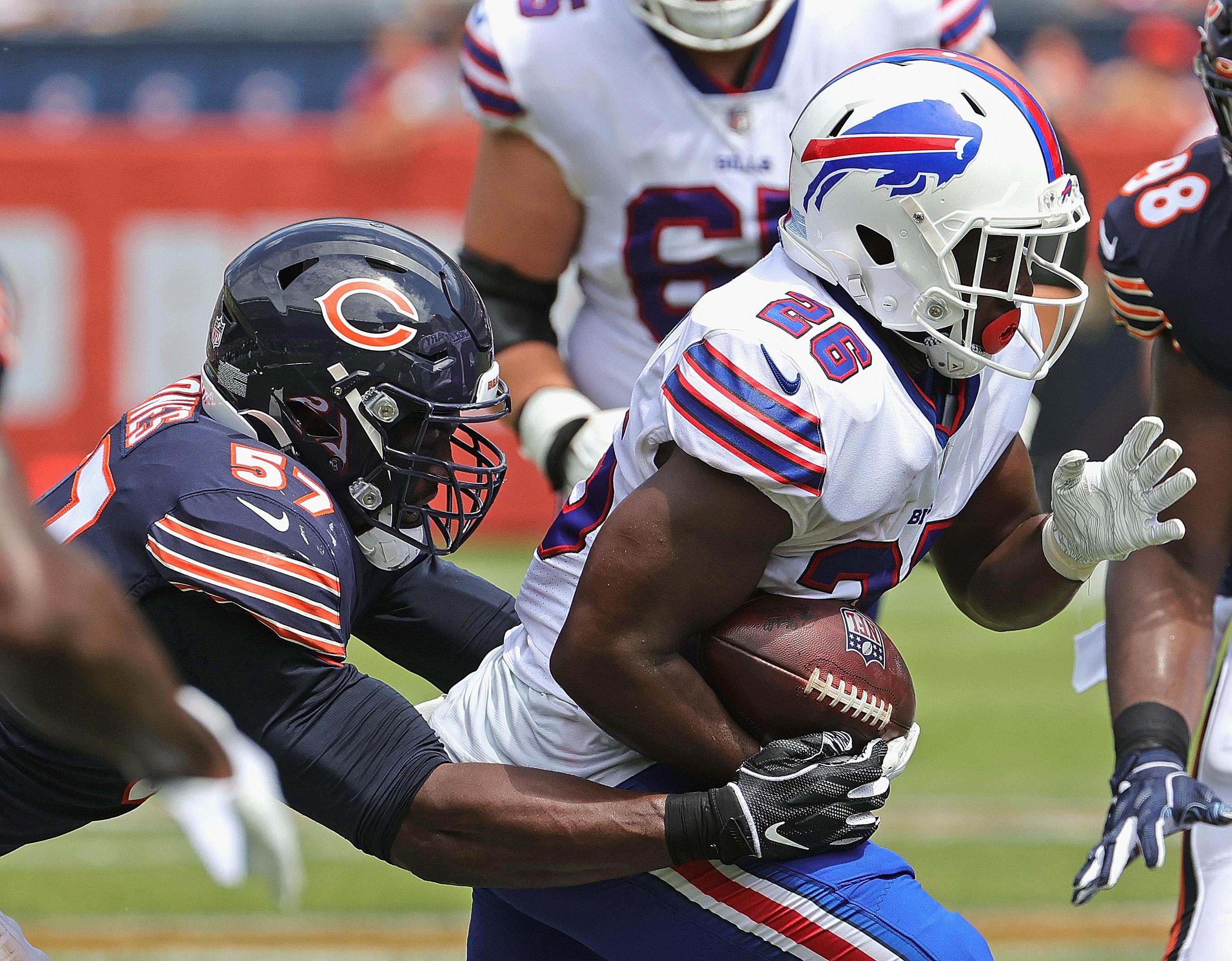 Bills running back Devin Singletary tries to break away from Bears linebacker Christian Jones on Saturday at Soldier Field.