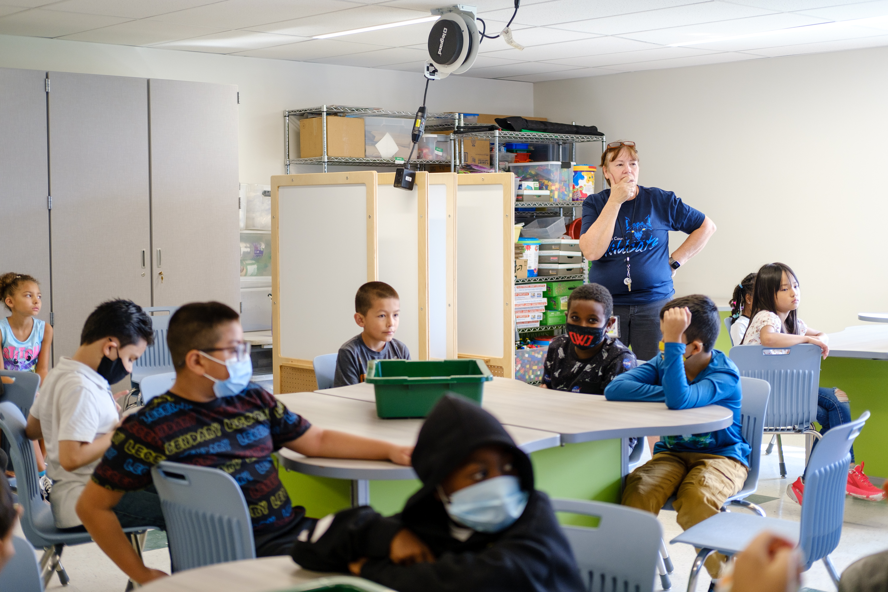 A teacher leads her students in a classroom discussion during a STEM class.