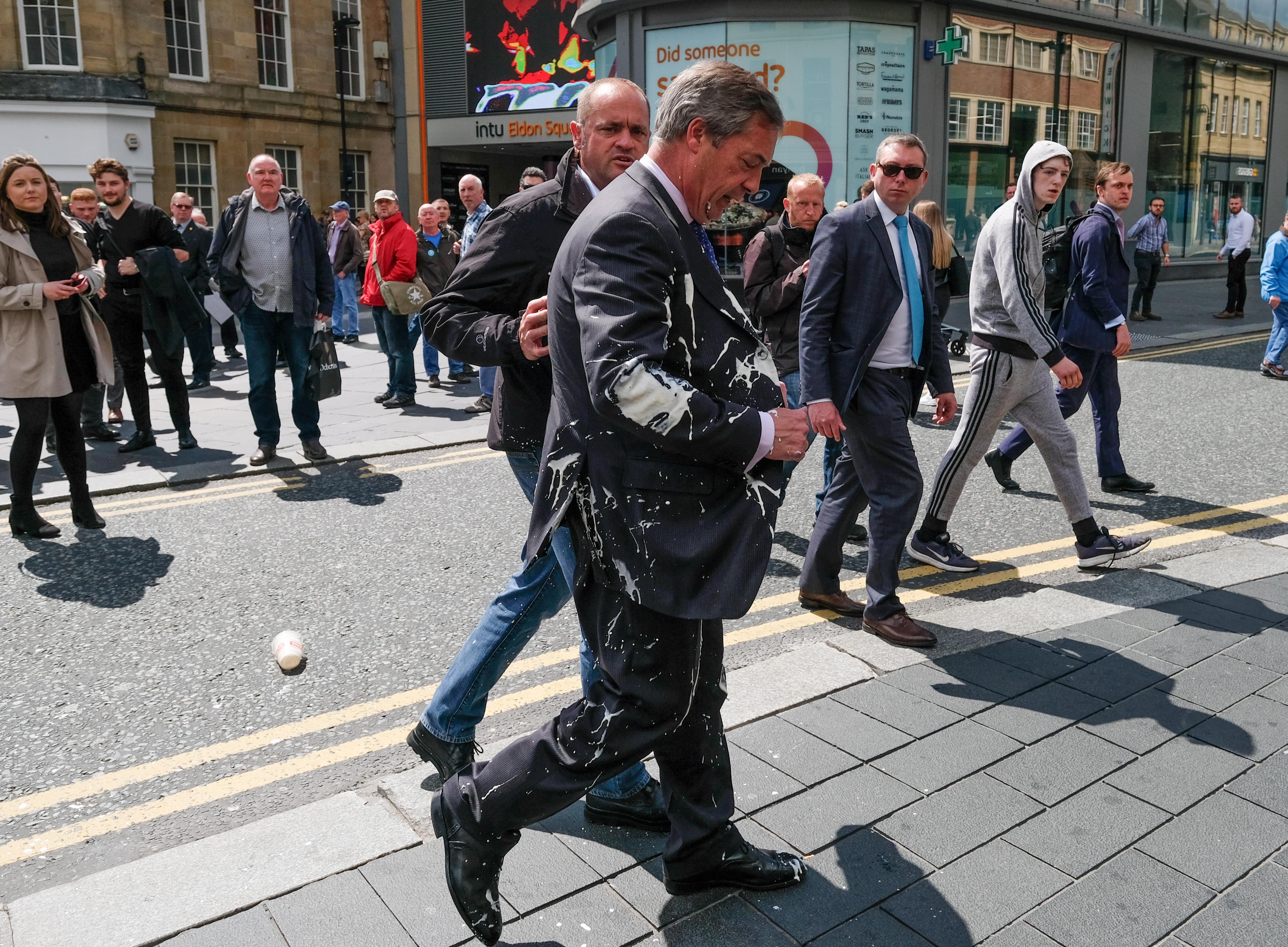 Nigel Farage splattered by milkshake