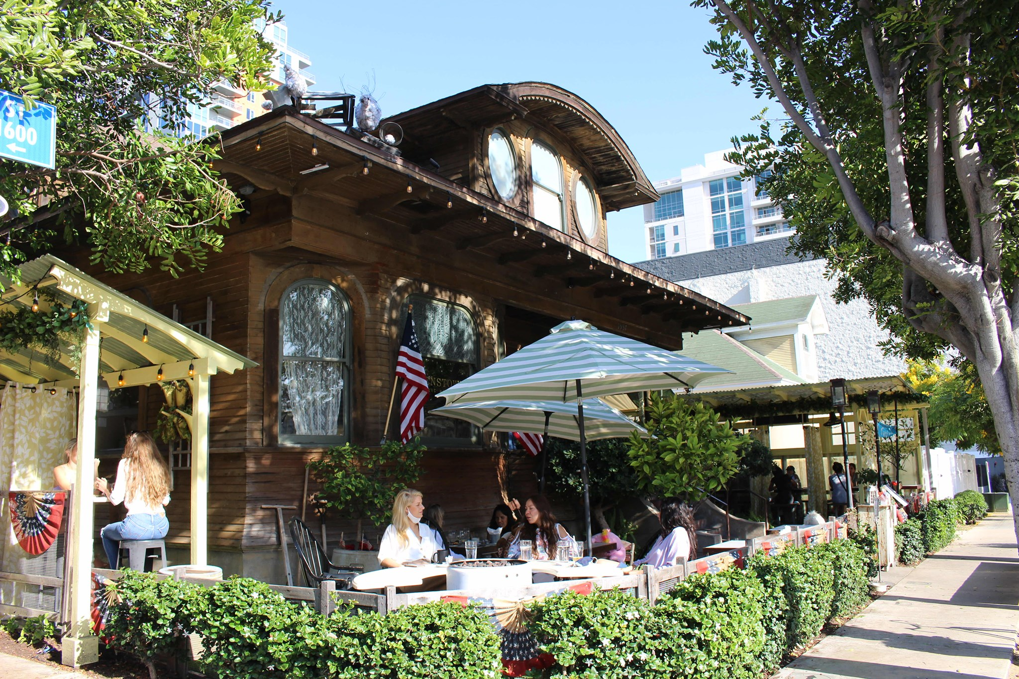 Corner patio and facade of Queenstown Public House in Little Italy