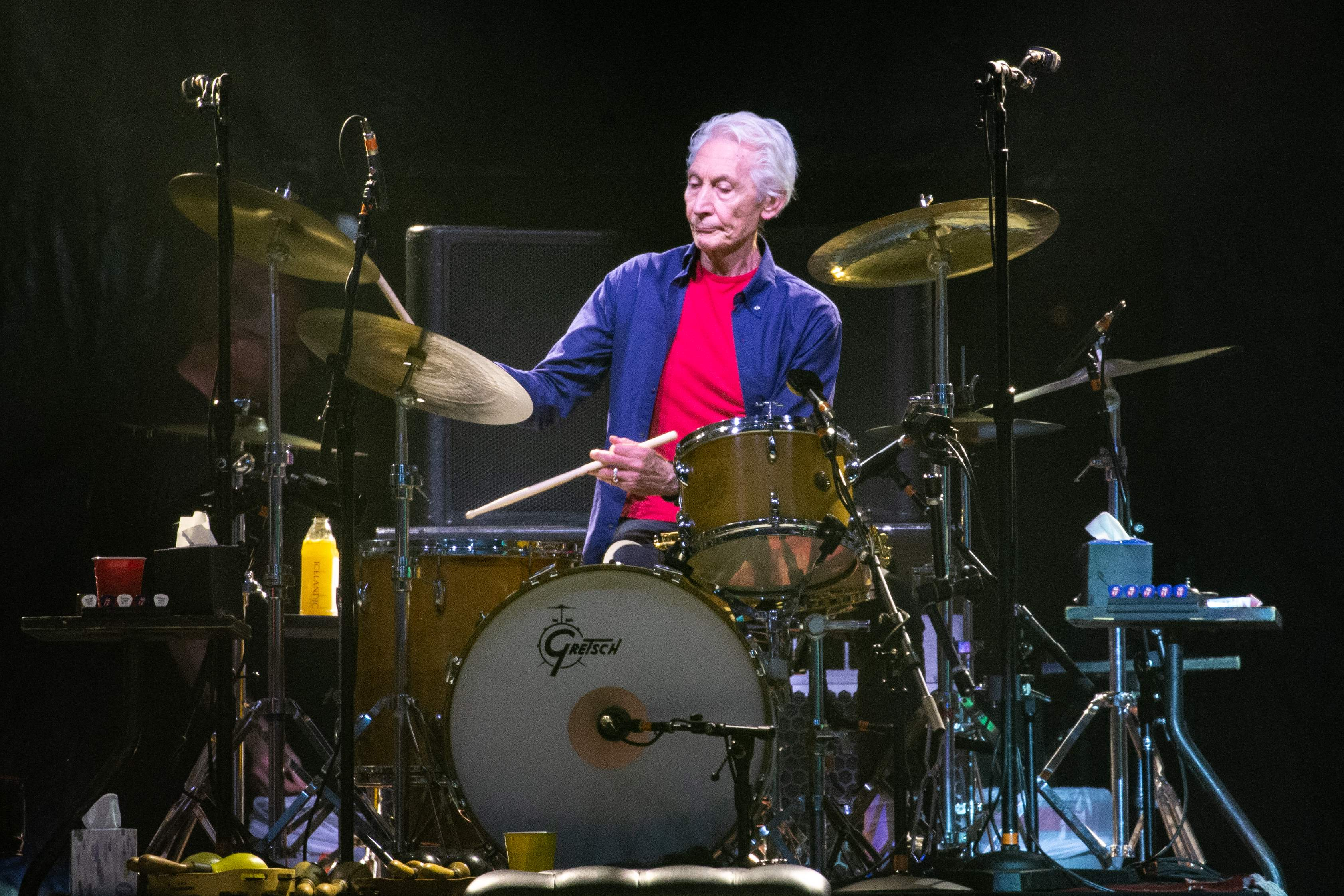 """In this file photo taken on July 28, 2019 The Rolling Stones drummer Charlie Watts performs on stage during their """"No Filter"""" tour at NRG Stadium in Houston, Texas. - Charlie Watts, drummer with legendary British rock'n'roll band The Rolling Stones, died on August 24, 2021 aged 80, according to a statement from his publicist."""