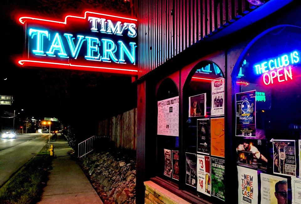 The neon sign outside Tim's Tavern in Greenwood.