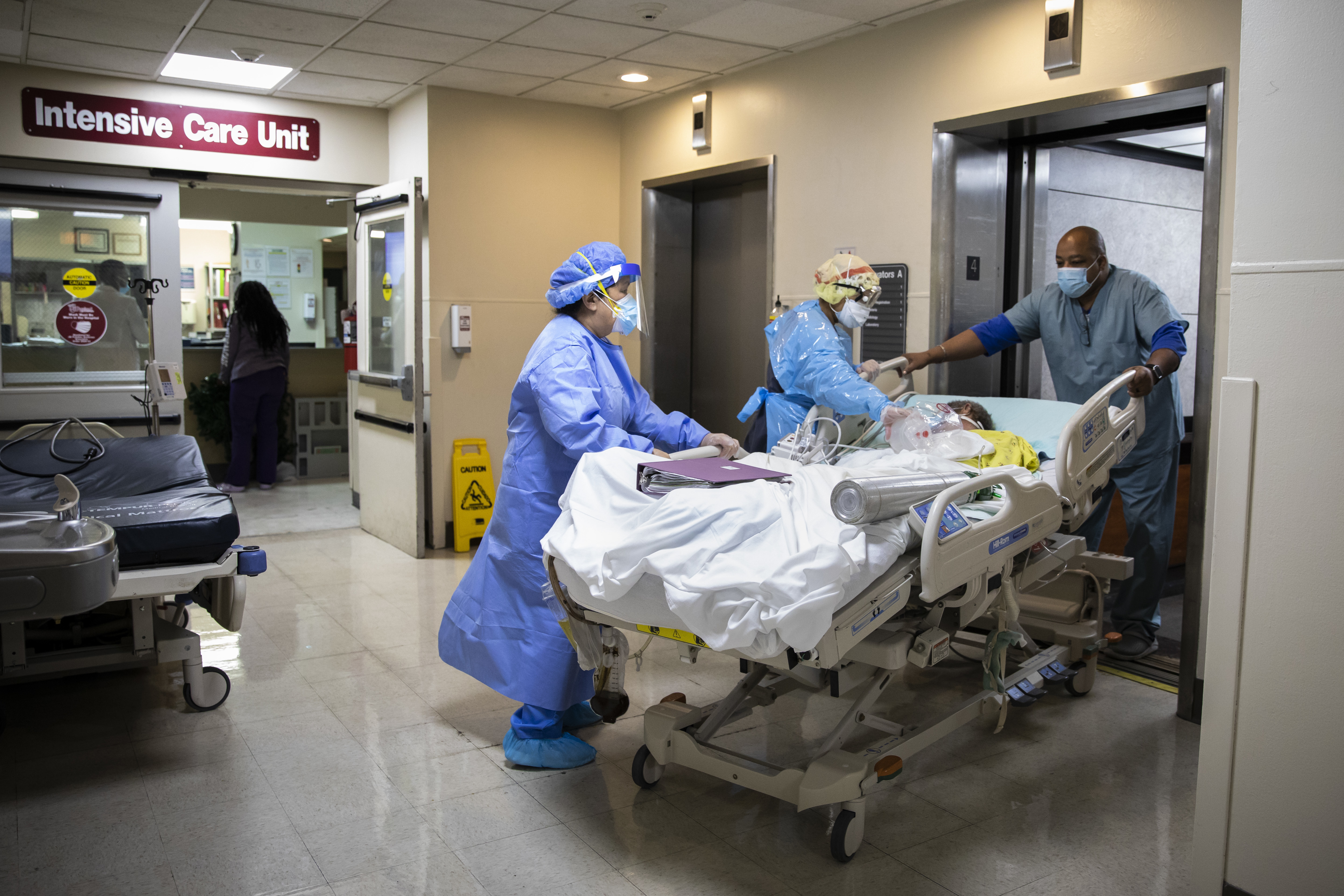 A patient is wheeled out of the Intensive Care Unit at Roseland Community Hospital on the Far South Side last December.