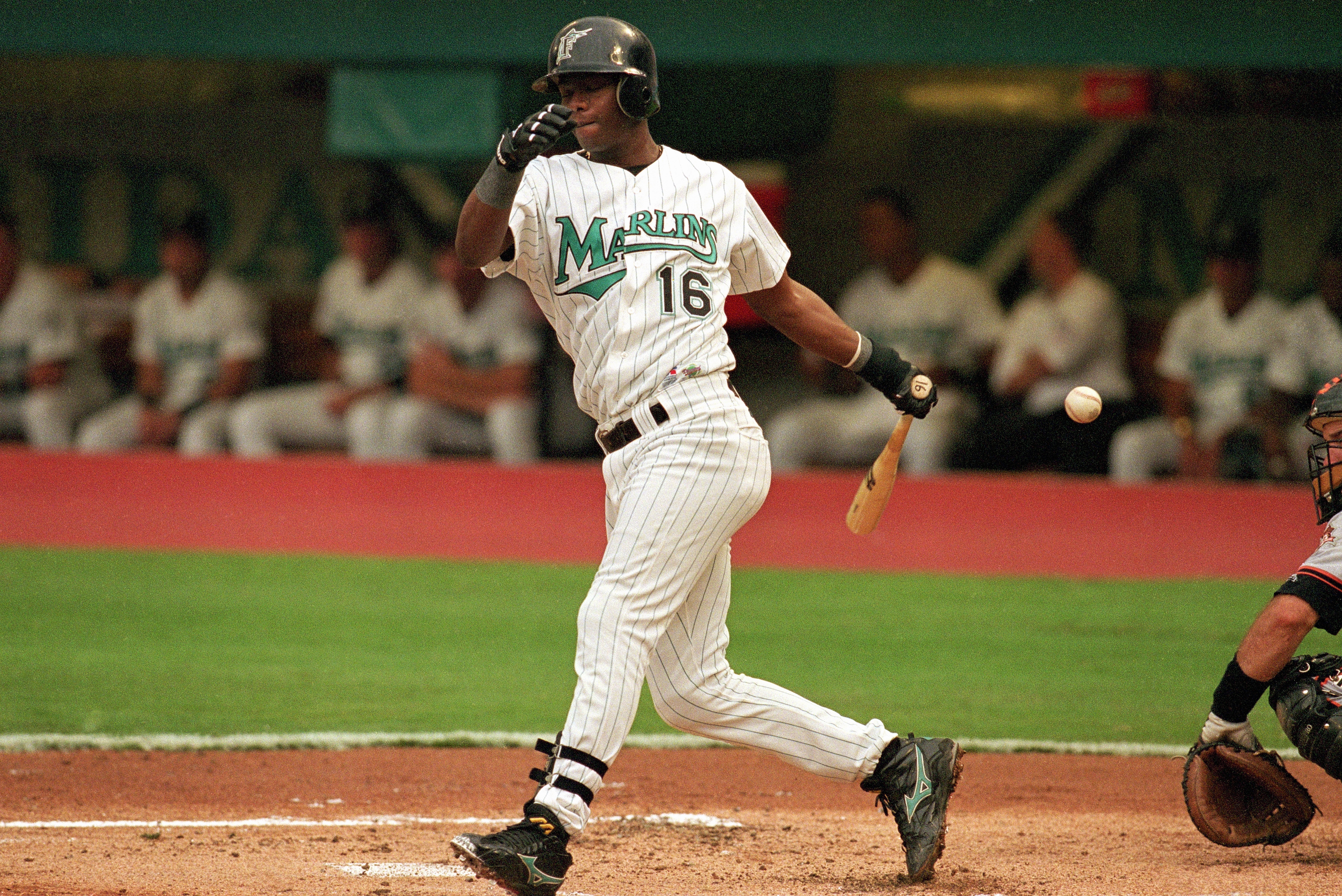 Edgar Renteria #16 of the Florida Marlins swings at a pitch during Game one of the 1997 National League Divisional Series against the San Francisco Giants at Pro Player Stadium
