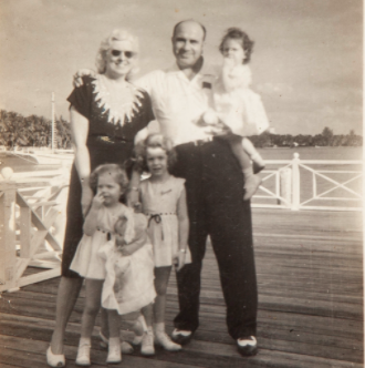 Family members say this vintage silver print of Mae and Al Capone standing on the pier with their grandchildren, taken on Dec. 25, 1946, is the last photo of him before he died. Al holds Barbara, and in the foreground are Diane (from left) and Ronnie.