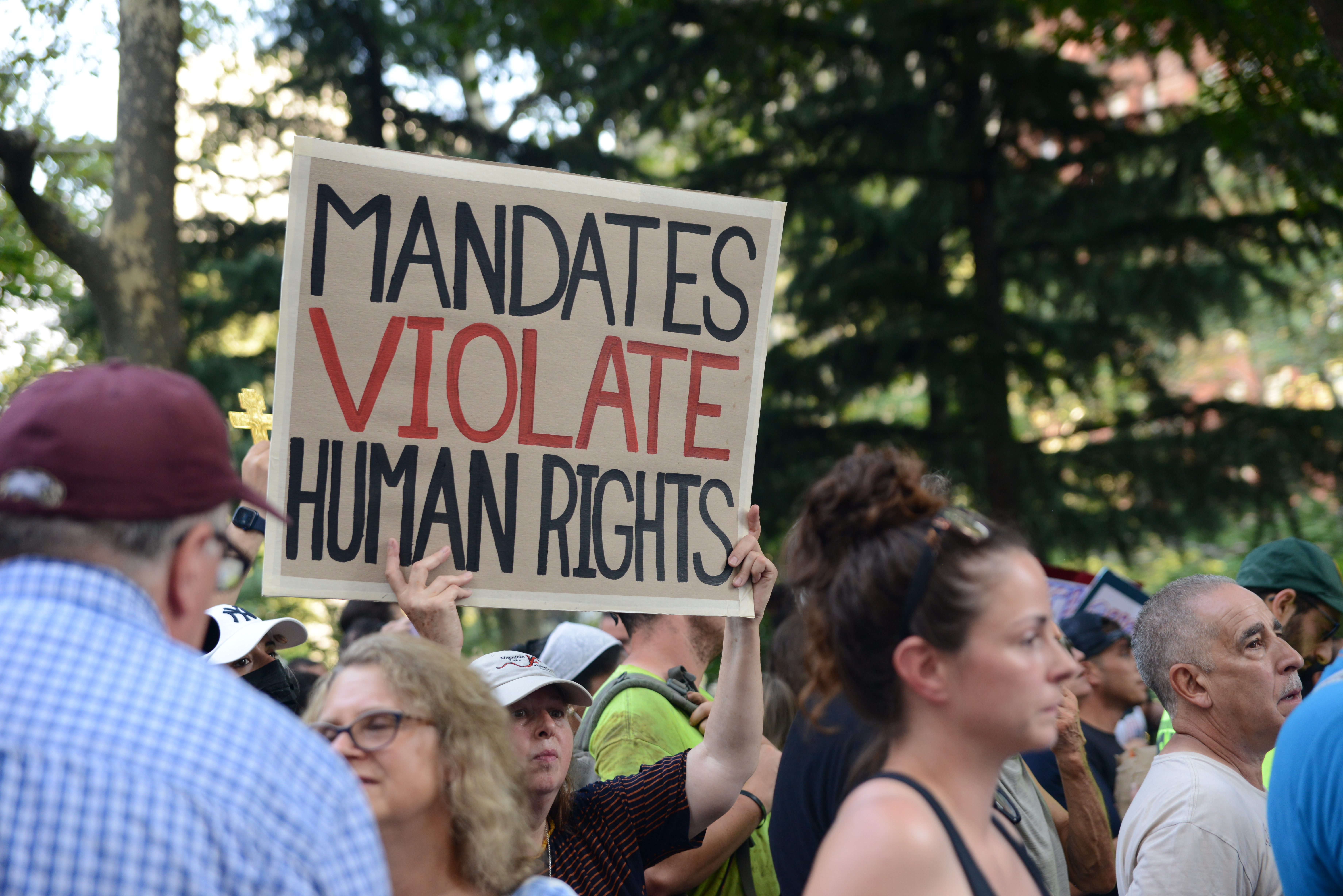 Hundreds of protesters, many of them city workers, demonstrated against vaccine mandates outside City Hall on Wednesday, Aug. 25, 2021.
