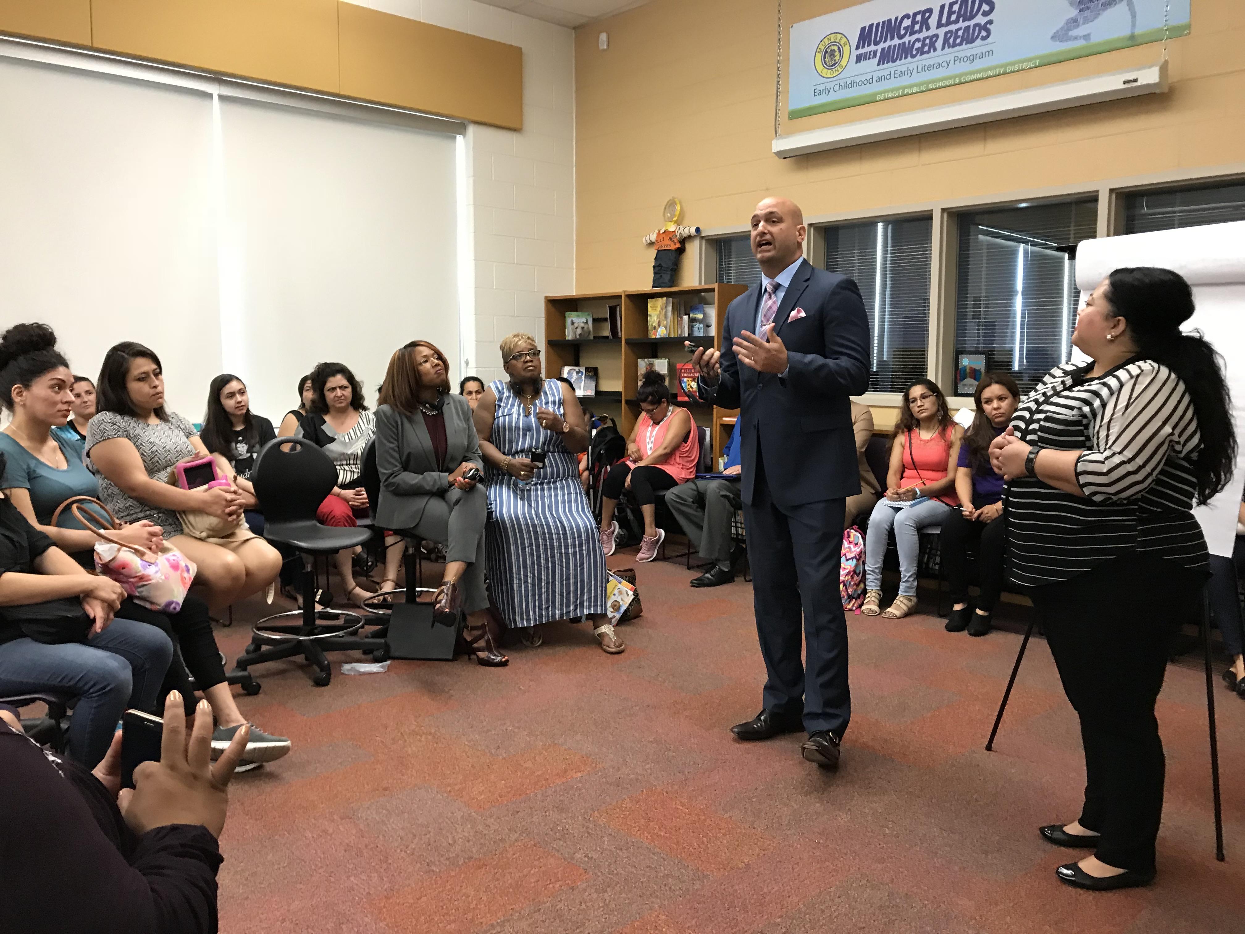 Detroit schools superintendent Nikolai Vitti addresses Spanish-speaking parents during a forum at Munger Elementary-Middle School.