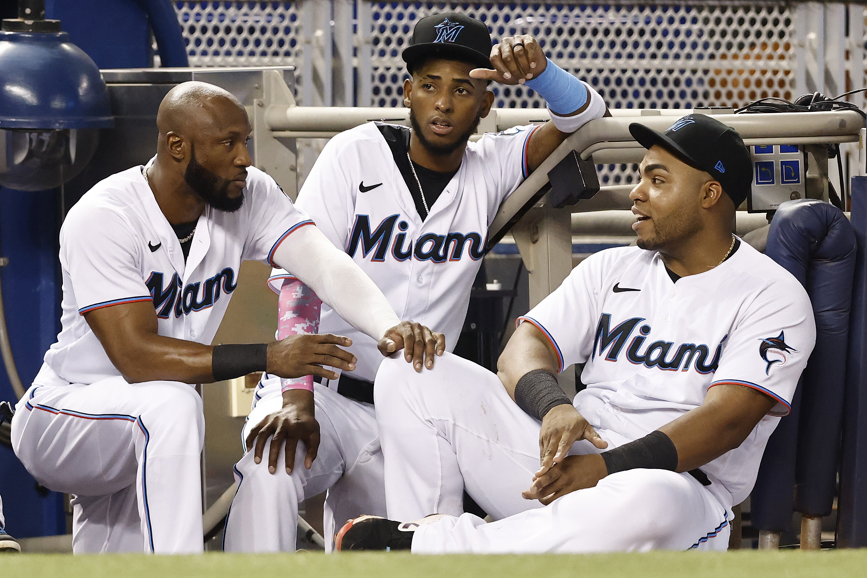 Lewin Diaz #68 and Jesus Aguilar #24 of the Miami Marlins look on against the Toronto Blue Jays at loanDepot park