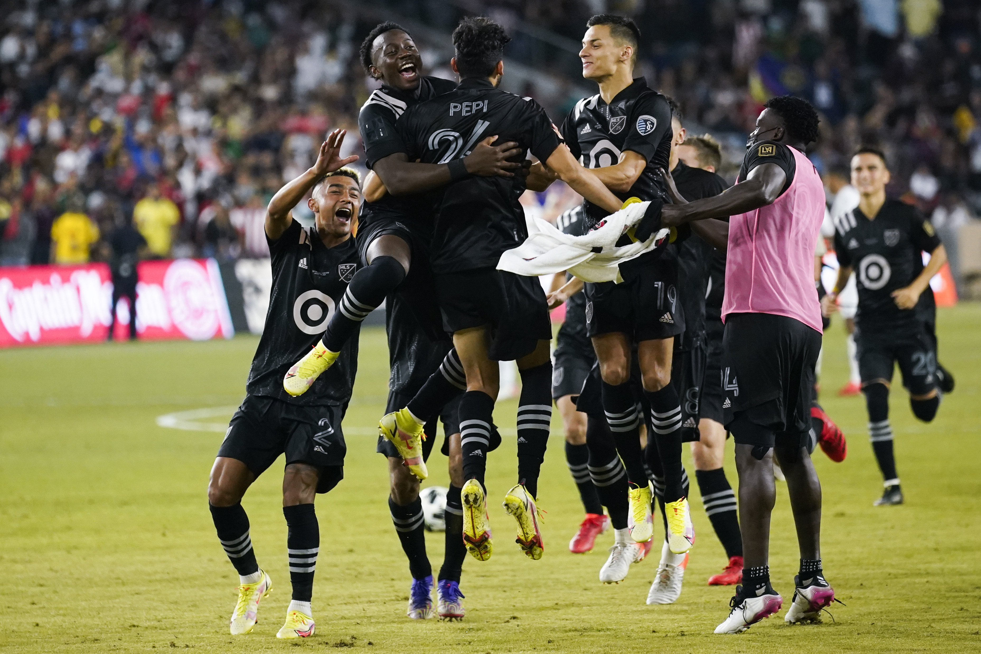 MLS All-Star players celebrate after FC Dallas forward Ricardo Pepi (24) scored the winning goal in a penalty shoot out against the Liga MX All-Stars during the MLS All-Star Game in Los Angeles.