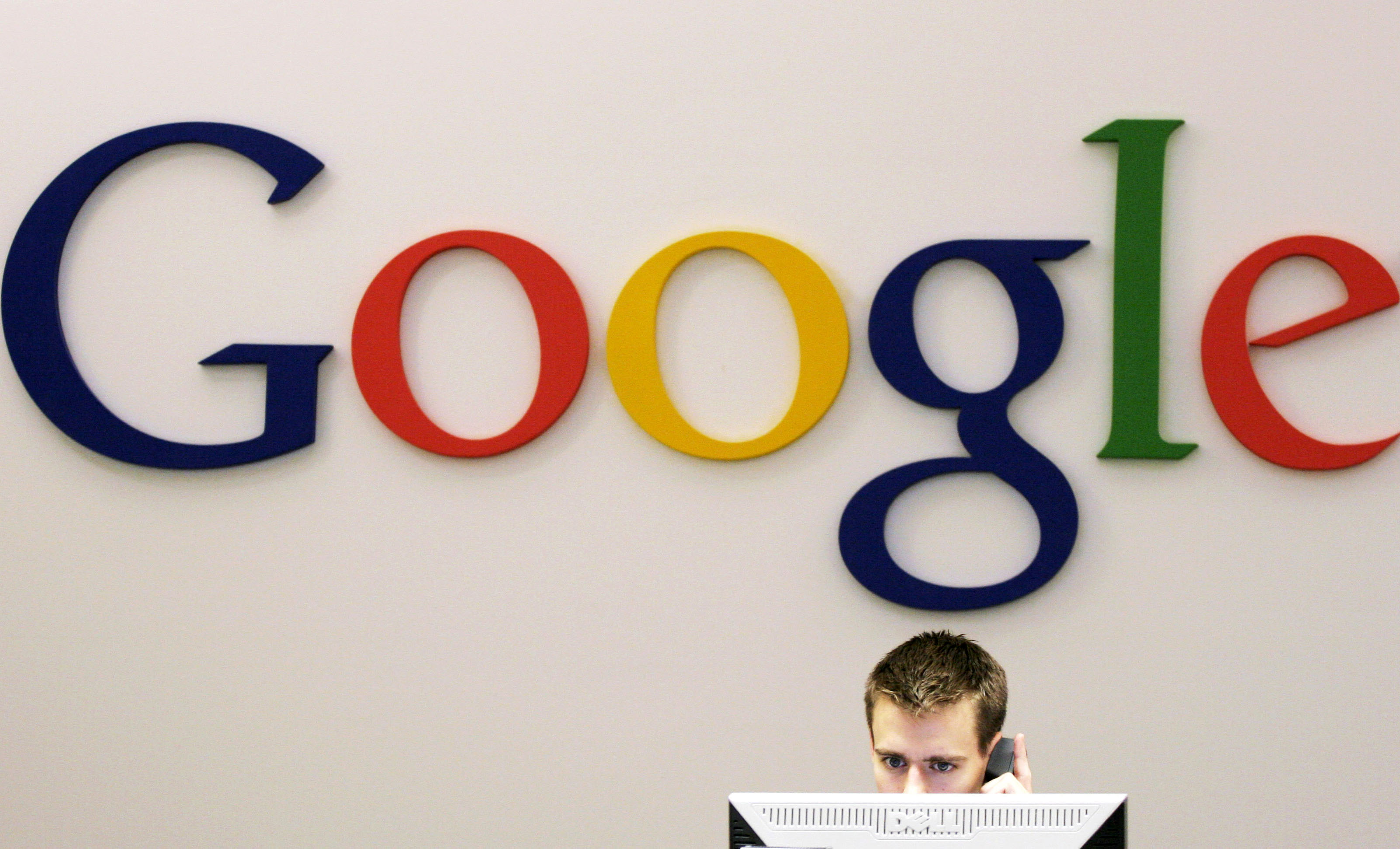 A Google receptionist works at the front desk in the company's office in New York.