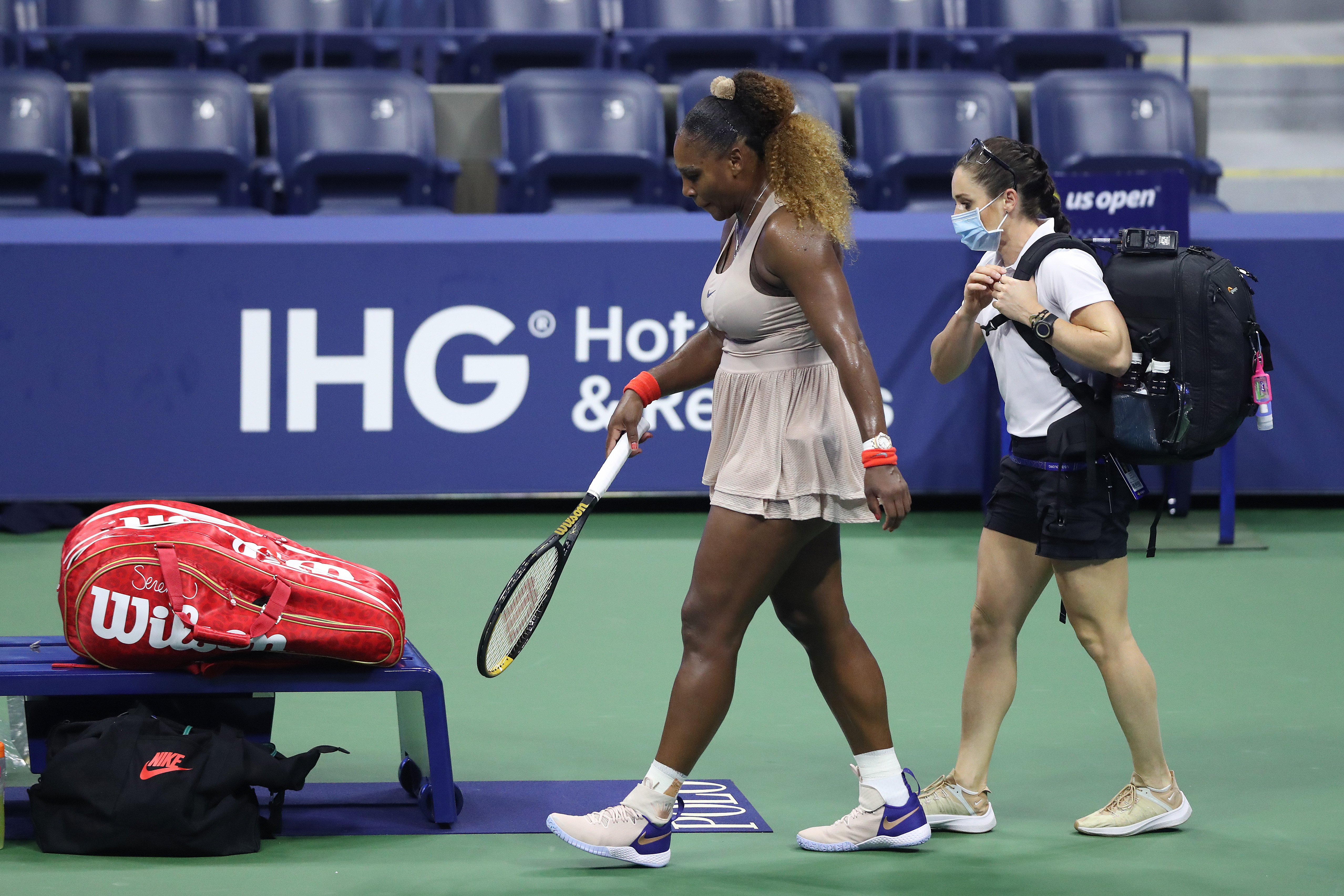 Serena Williams of the United States walks to her seat due to an injury in the third set during her Women's Singles semifinal match against Victoria Azarenka of Belarus on Day Eleven of the 2020 US Open at the USTA Billie Jean King National Tennis Center on September 10, 2020 in the Queens borough of New York City.