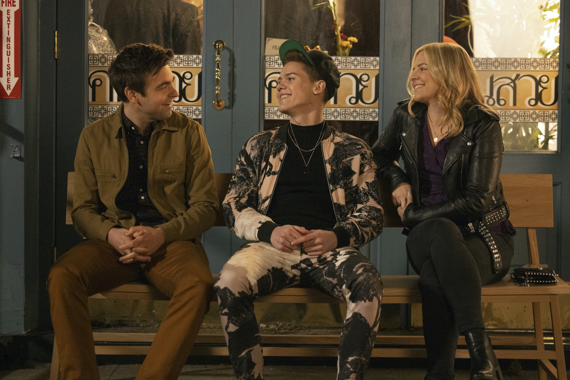 Teen pop star Chase Dreams sits between his siblings Cary and Brooke in the HBO Max comedy The Other Two.