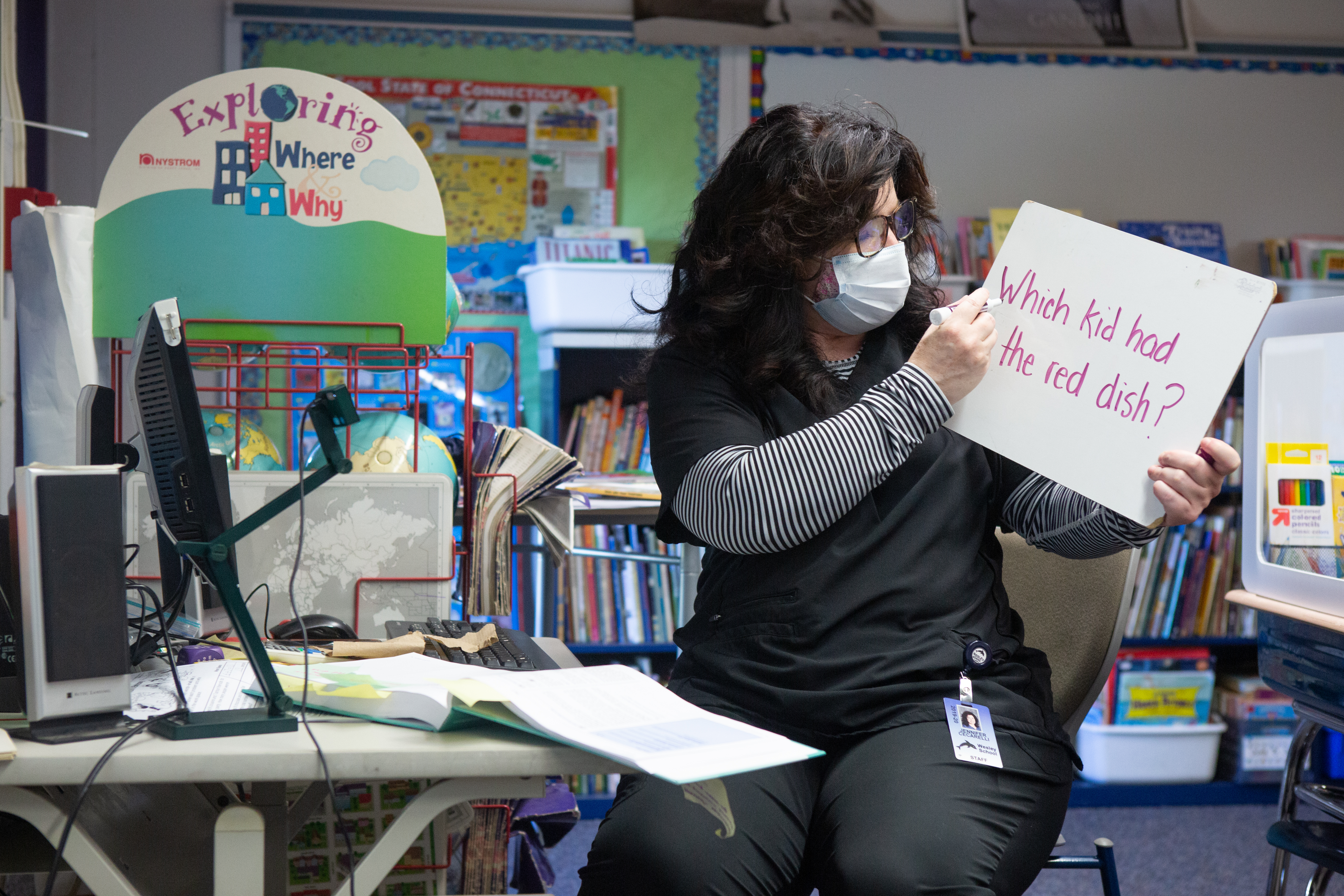 Second grade teacher Mrs. Cecarelli uses a white board to teach both her in-class and online students at Wesley Elementary School in Middletown, CT, October 5, 2020.