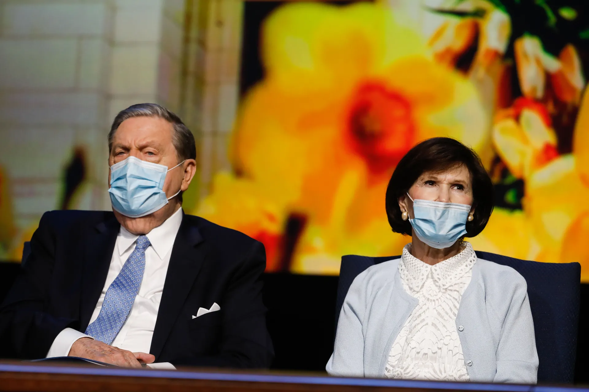 Elder Jeffrey R. Holland, of the Quorum of the Twelve Apostles of The Church of Jesus Christ of Latter-day Saints, and his wife, Sister Patricia Holland, wear masks while sitting on the stand at the BYU Annual University Conference, in Provo.
