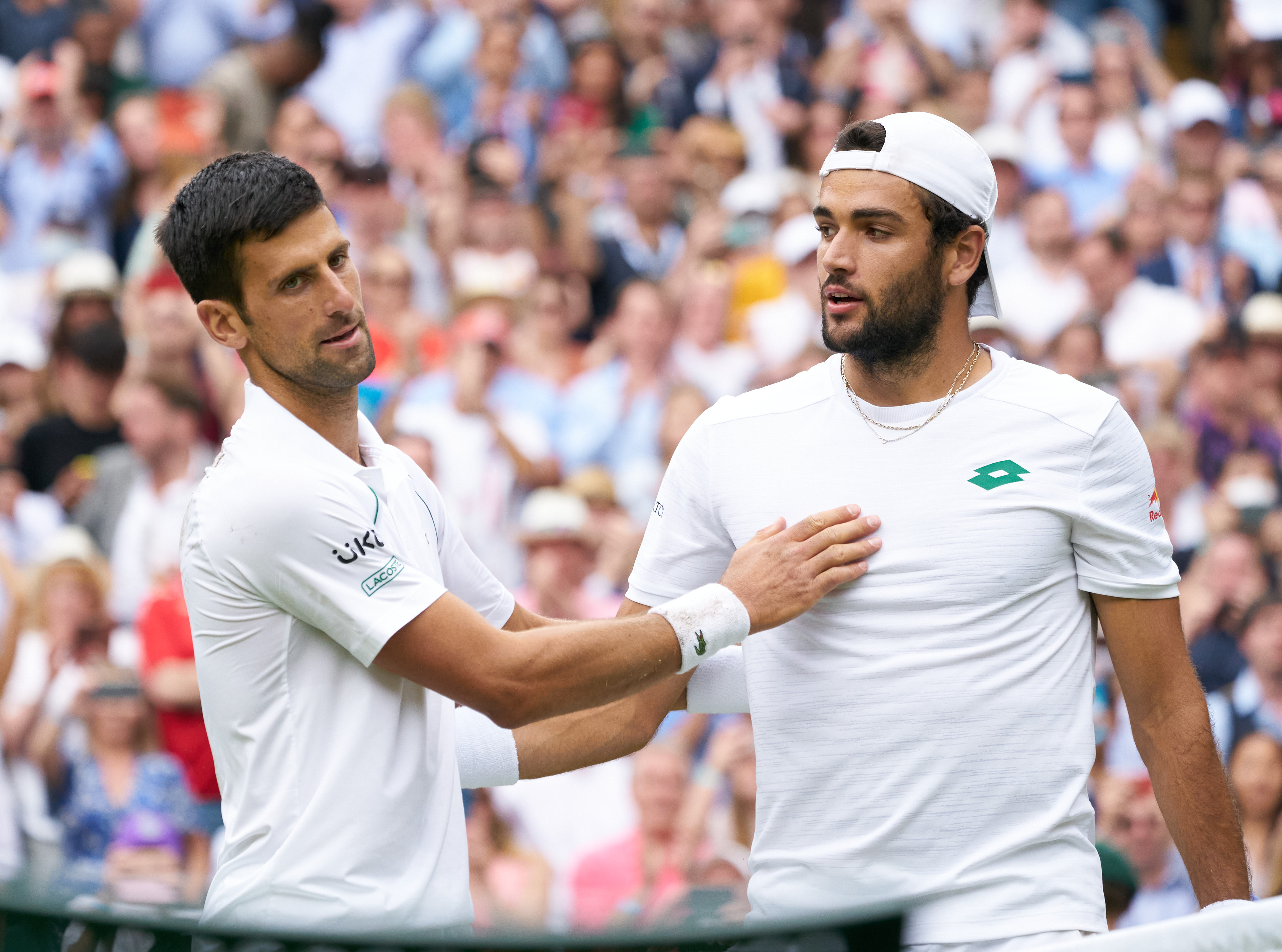 Novak Djokovic (SRB) at the net with Matteo Berrettini (ITA) after winning the mens final on Centre Court at All England Lawn Tennis and Croquet Club.