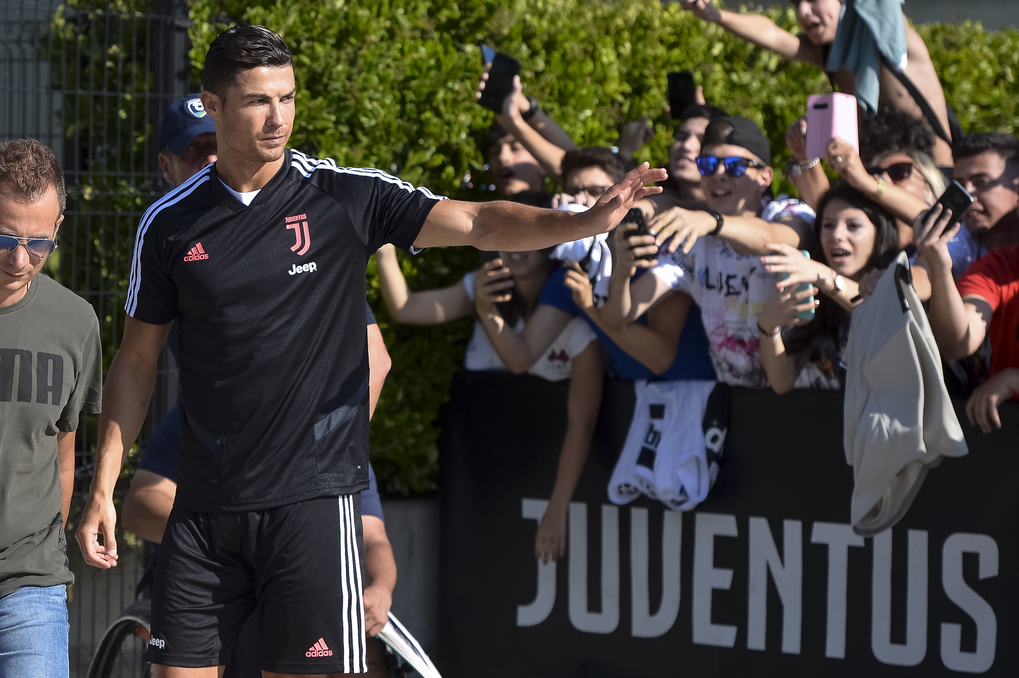 Juventus player Cristiano Ronaldo waves to suppoters as he...