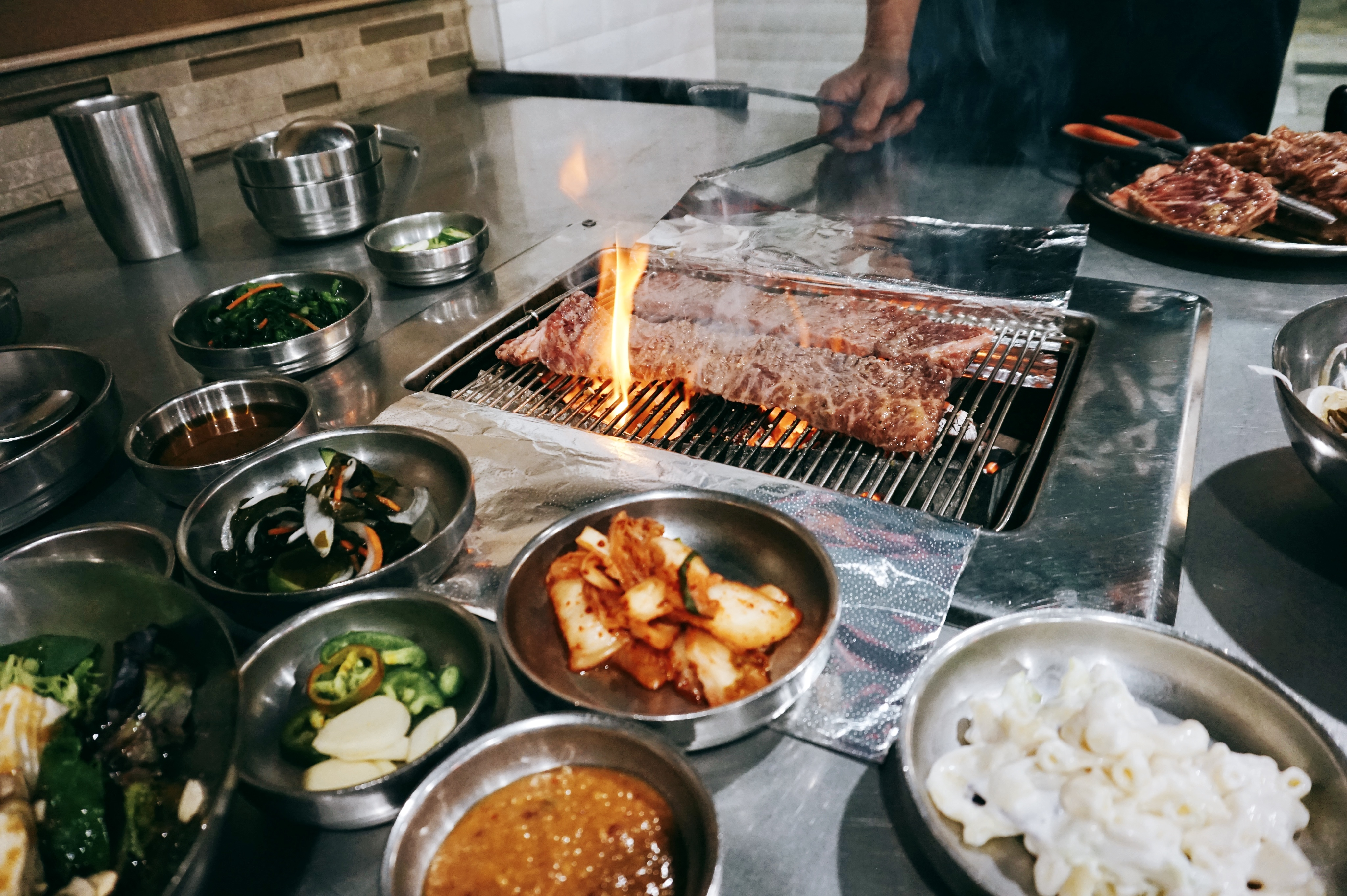 Korean Spring BBQ, the first wooden charcoal grill KBBQ restaurant to open in the Bay Area, lists over 60 dishes on its menu.