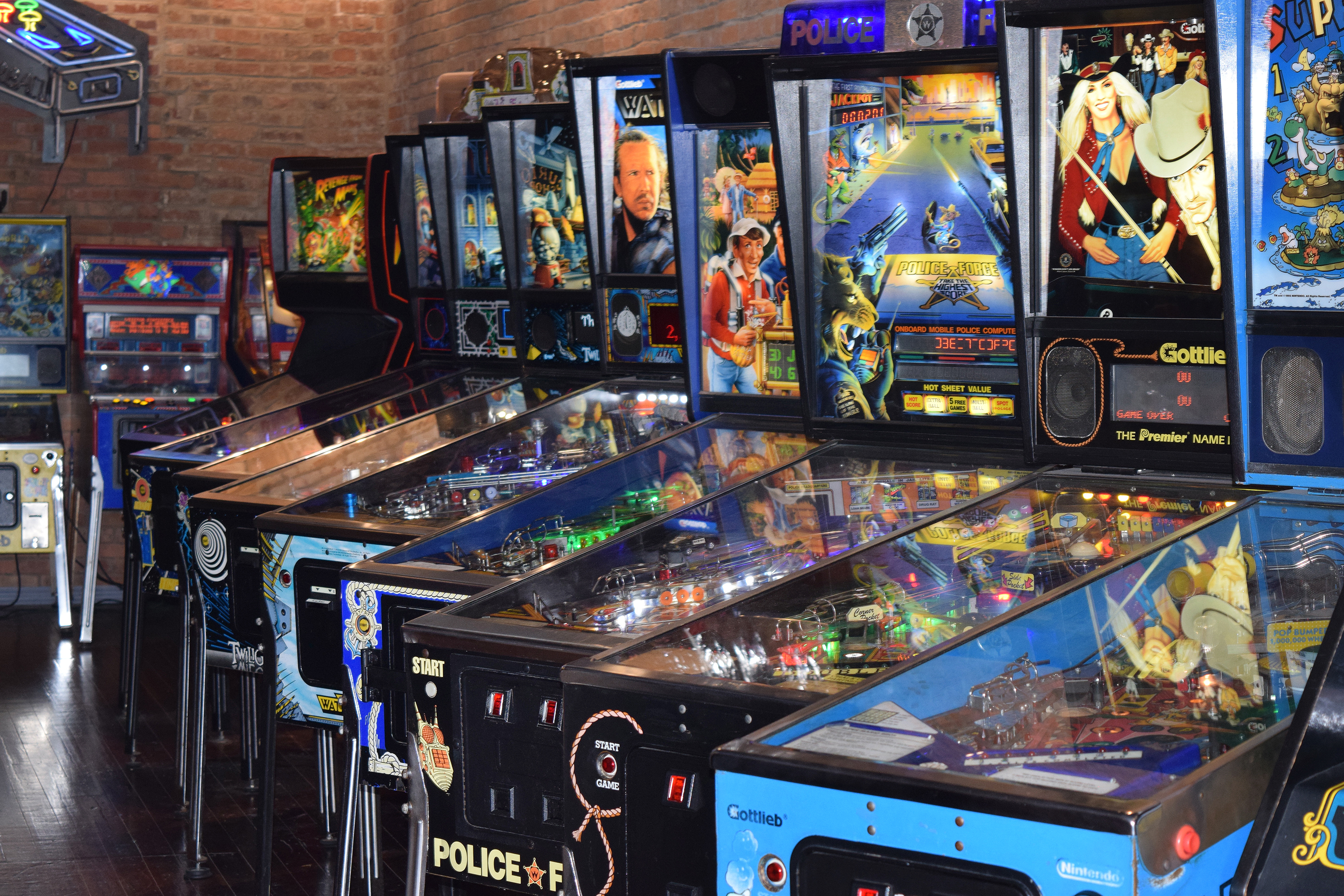 A row of classic pinball machines