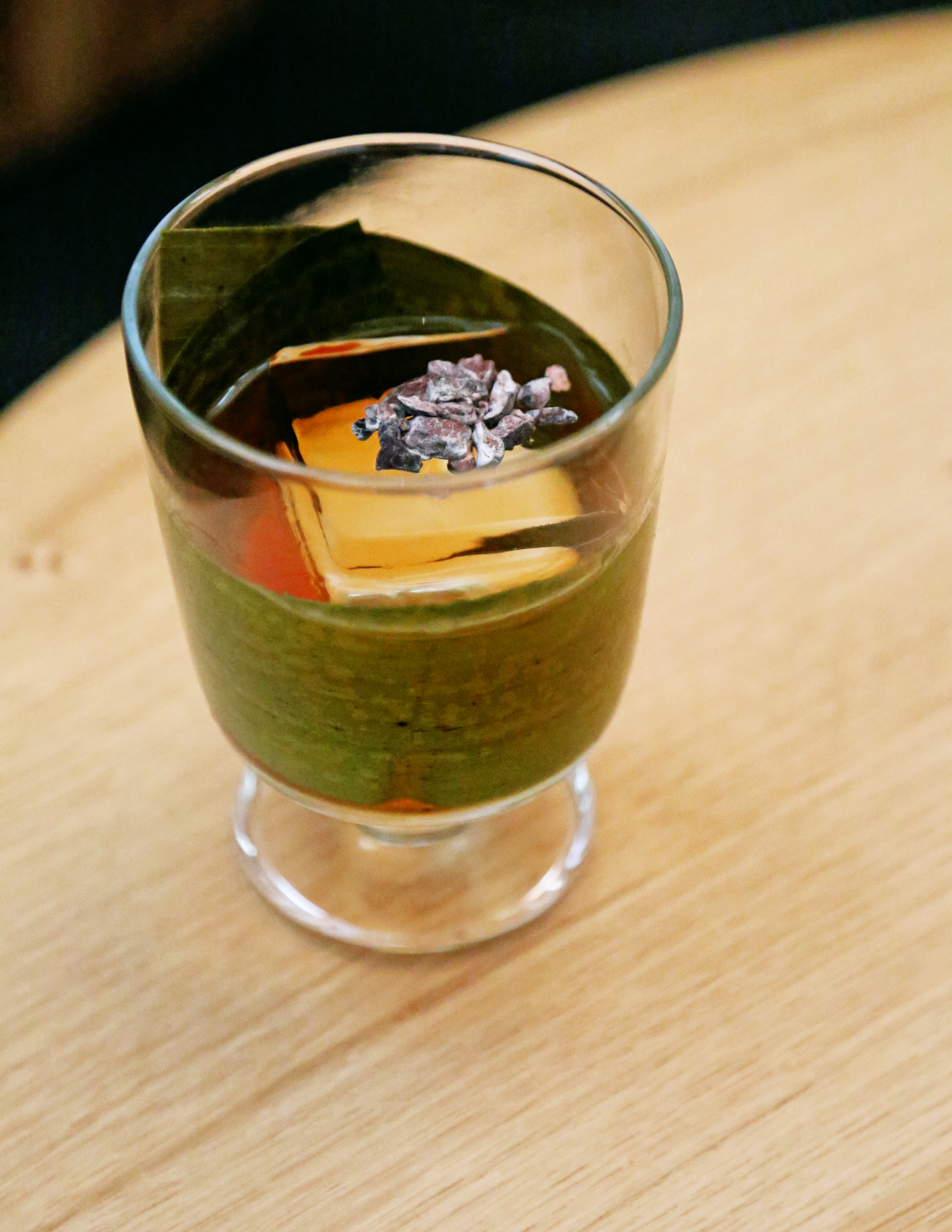 A cocktail wrapped in a banana leaf from Traveler bar