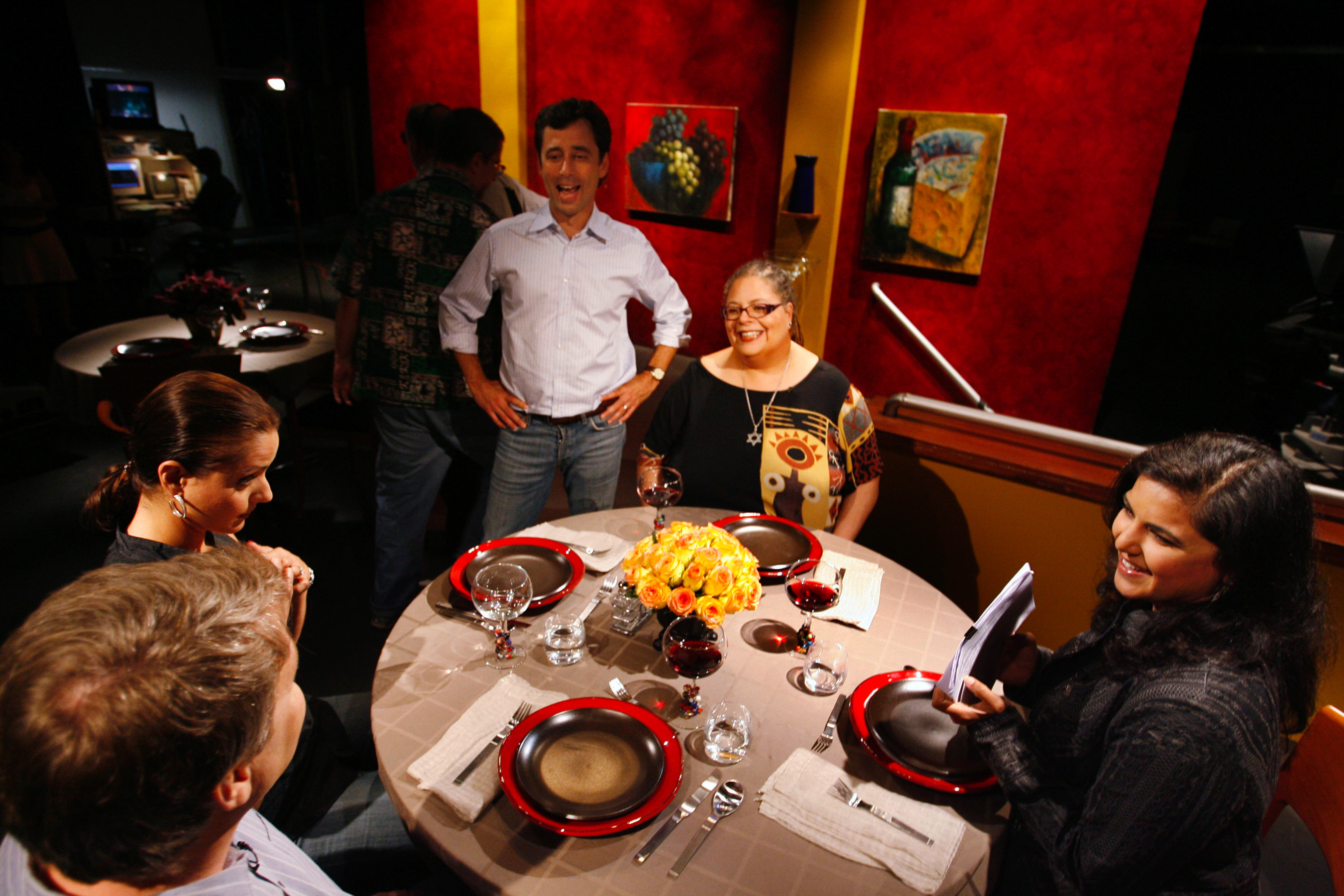 """Producer David Manilow, standing, speaks with guests on the set of """"Check, Please!"""" (AP Photo/Nam Y. Huh) ORG XMIT: CX404"""