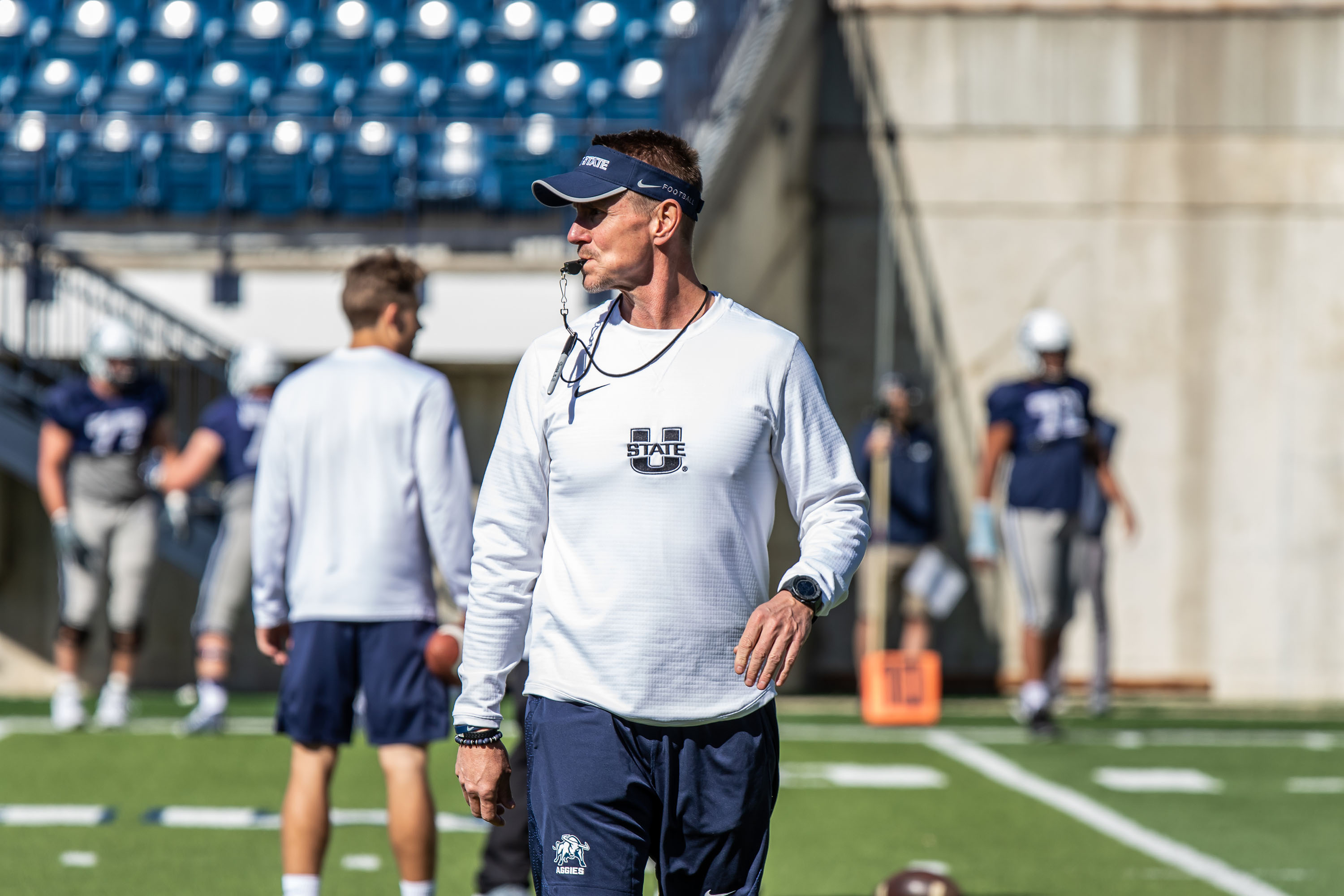 Utah State football coach Gary Andersen. shown in action during spring camp in Logan, is now joining the Weber State staff.
