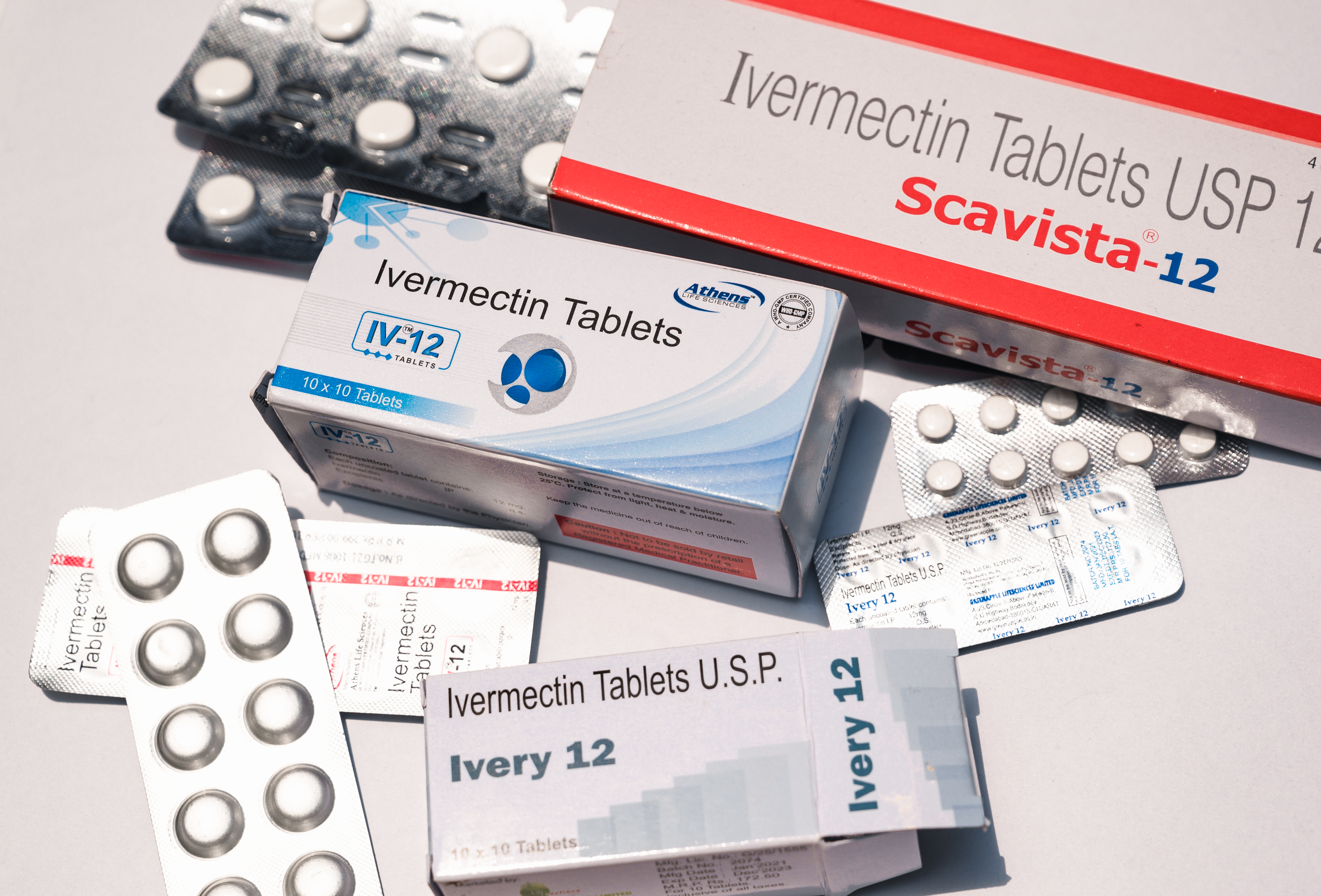 An assortment of boxes and blister packs of ivermectin.