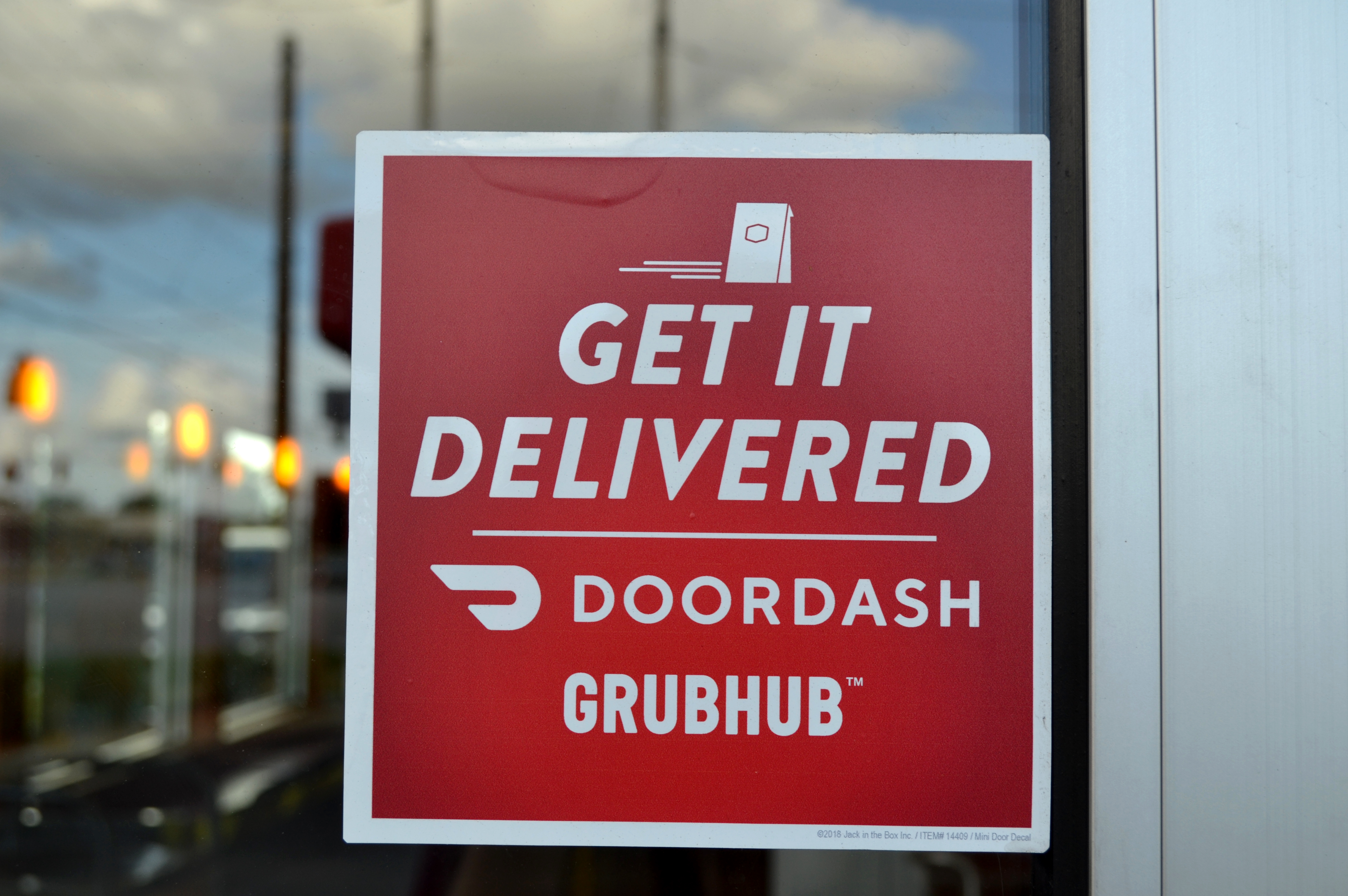 A Grubhub and DoorDash decal.