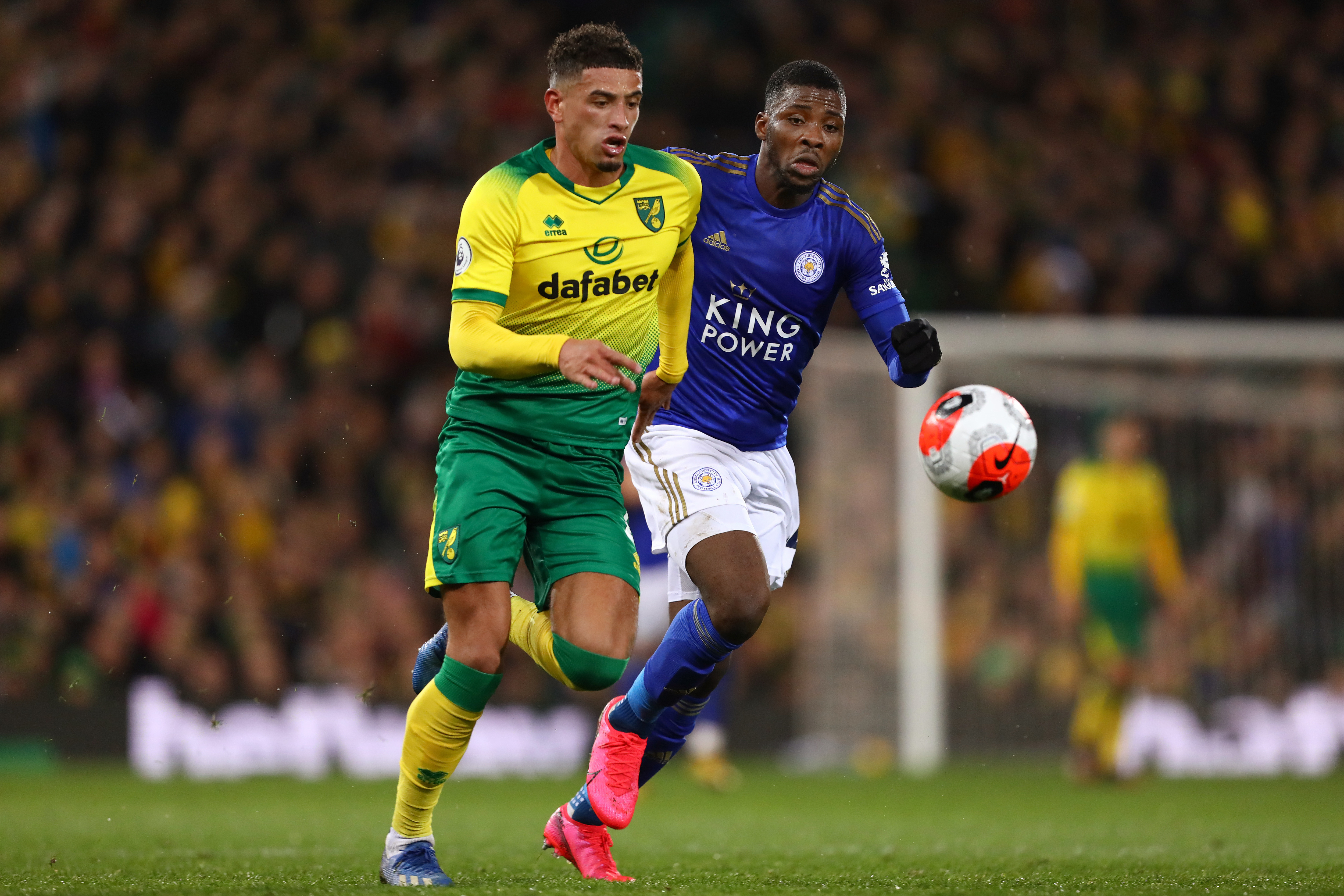 Ben Godfrey (L) and Kelechi Iheanacho (R) in action during...