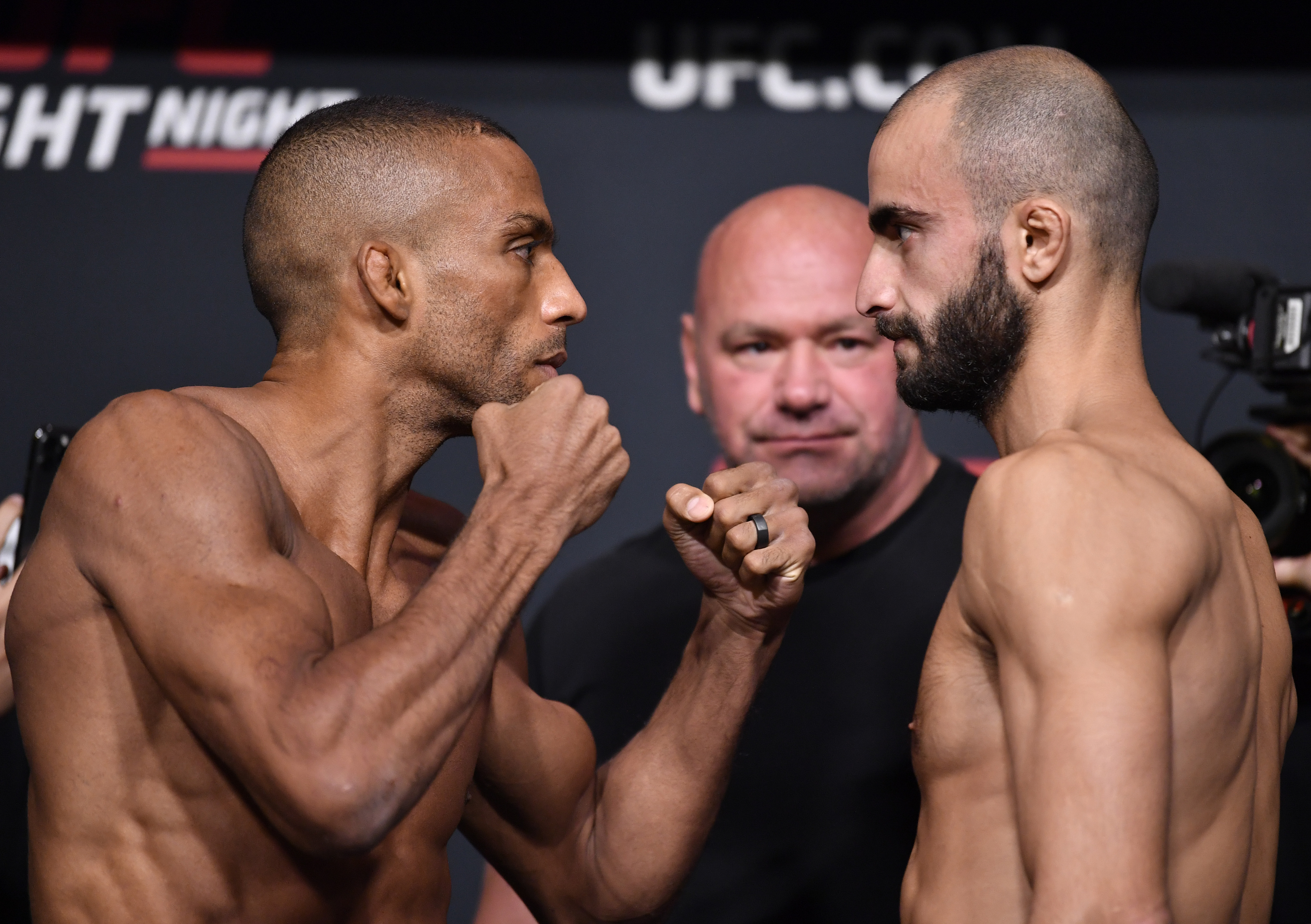 (L-R) Opponents Edson Barboza of Brazil and Giga Chikadze of Georgia face off during the UFC Fight Night weigh-in at UFC APEX on August 27, 2021 in Las Vegas, Nevada.