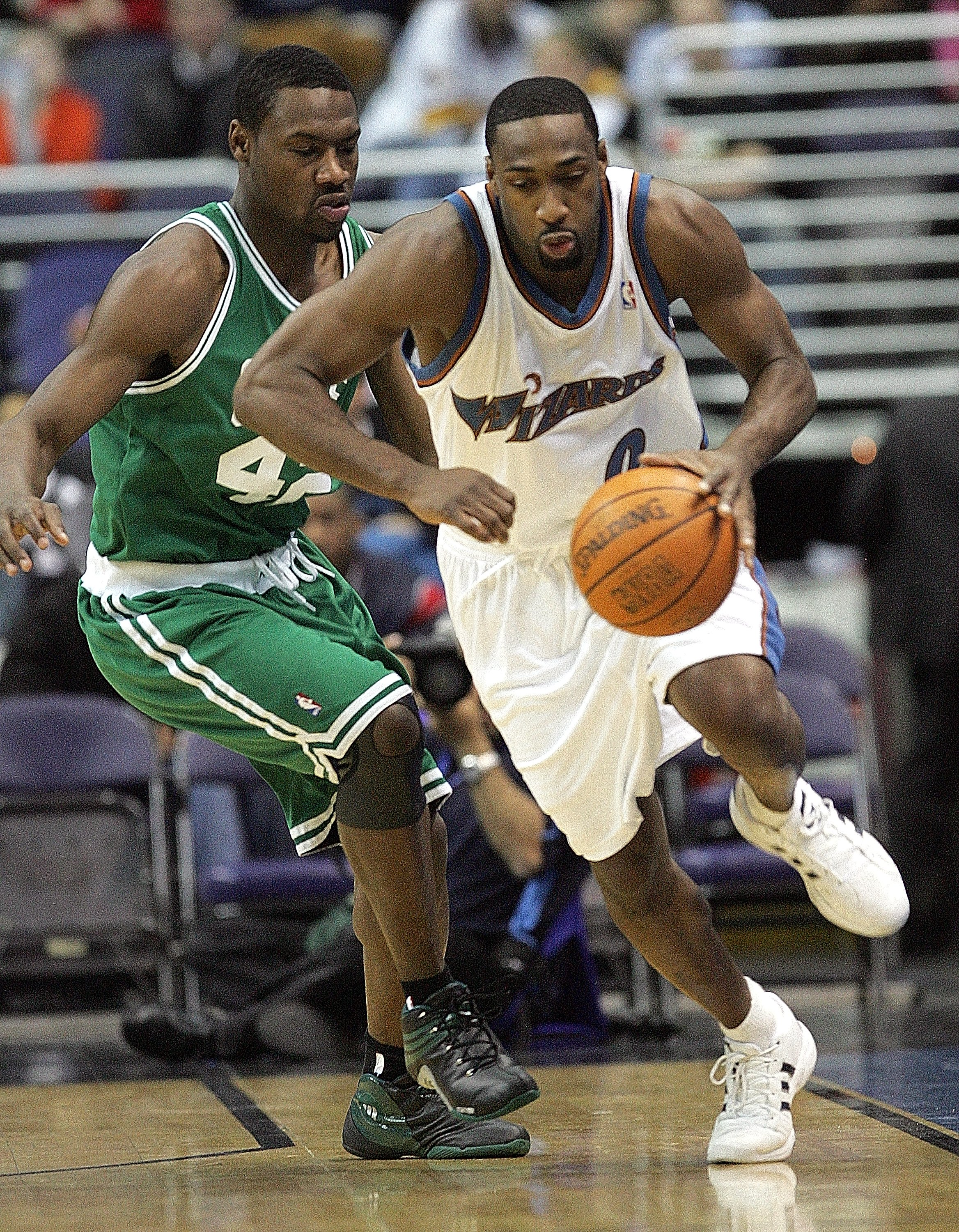 Washinton Wizards Gilbert Arenas (0) breaks free from pressure by Boston Celtics Tony Allen (42) during their game played at the MCI Center in Washington, D.C., Saturday night, January 7, 2006.