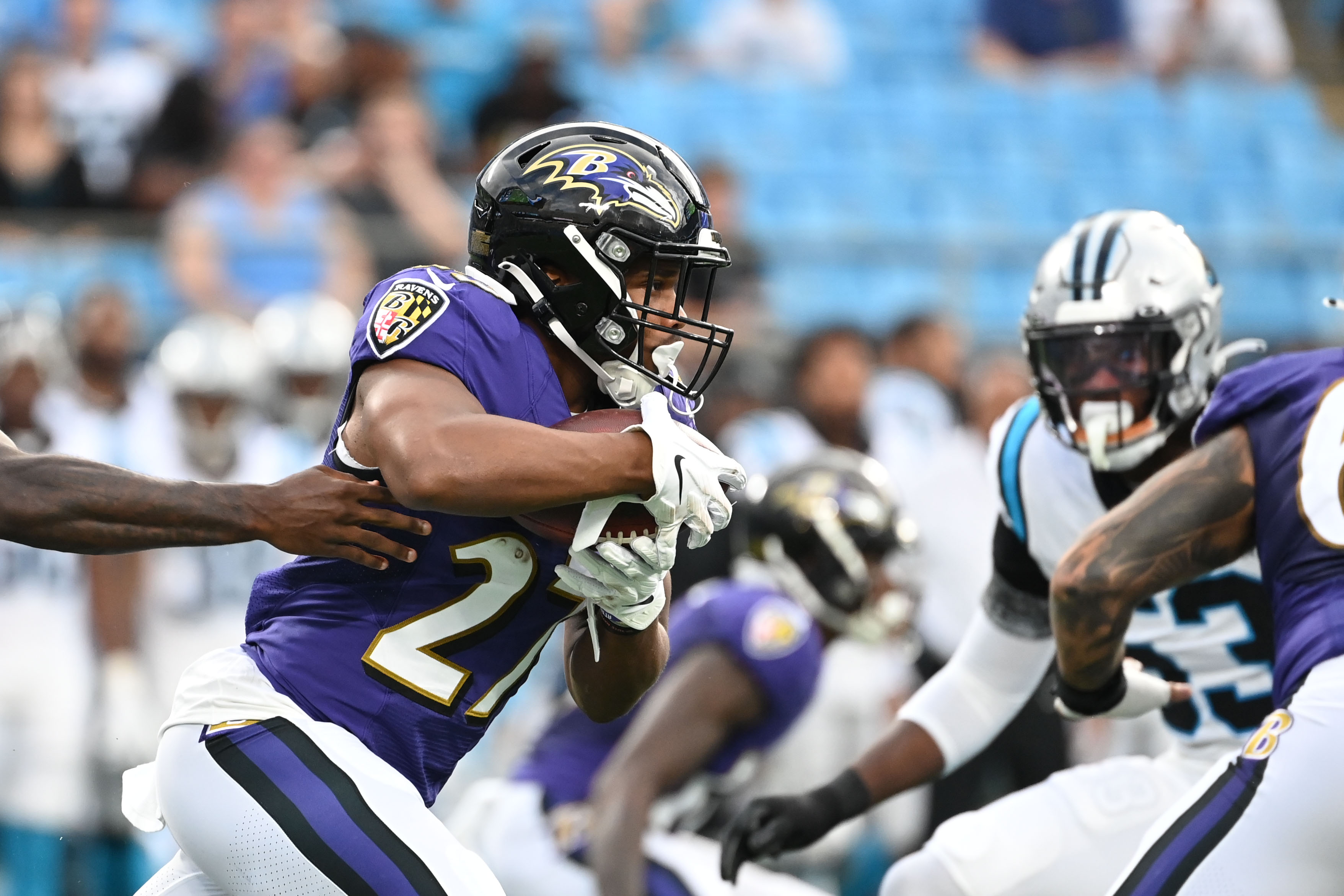 Baltimore Ravens running back J.K. Dobbins (27) with the ball in the first quarter at Bank of America Stadium.