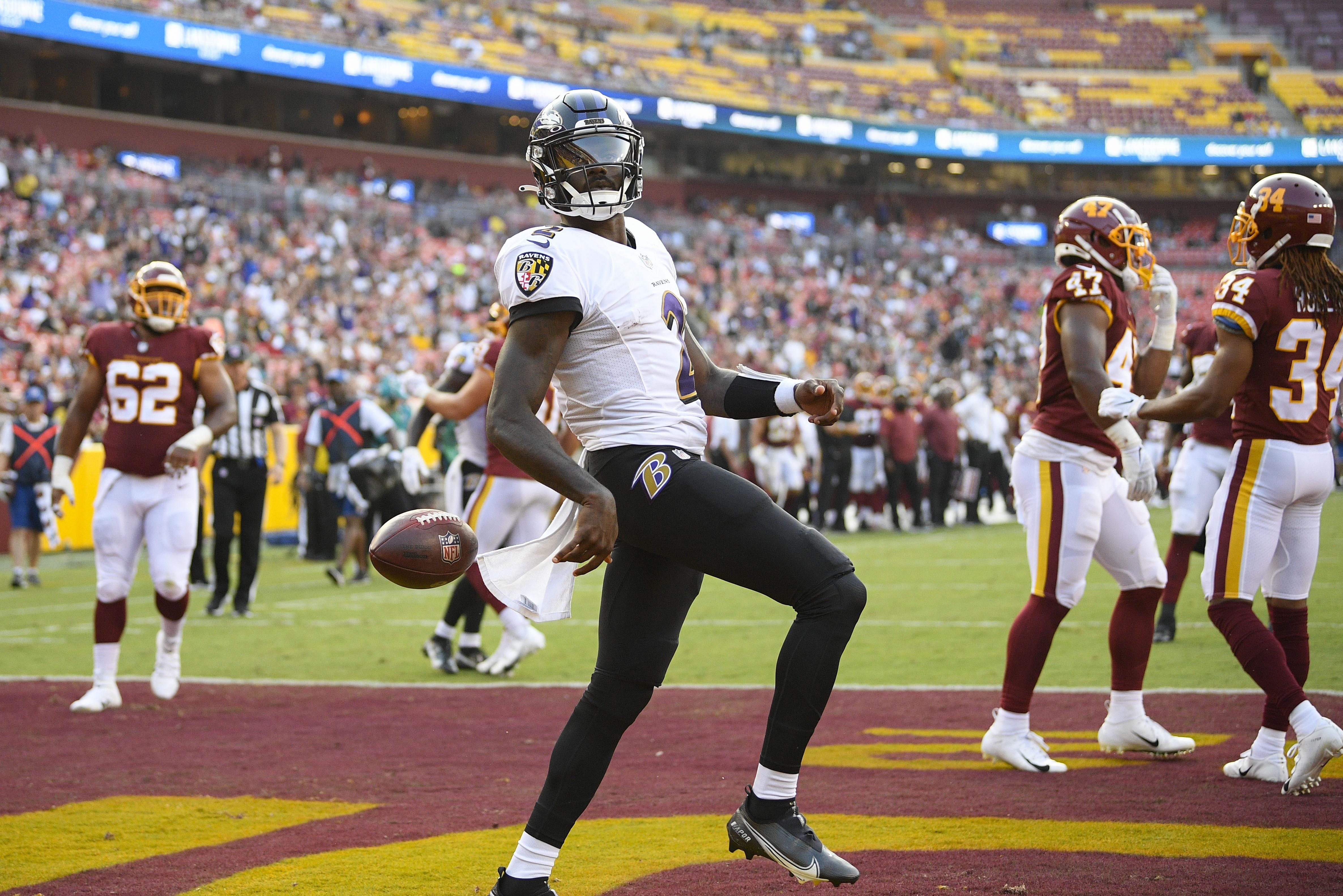 Baltimore Ravens quarterback Tyler Huntley (2) celebrating his touchdown against the Washington Football Team.