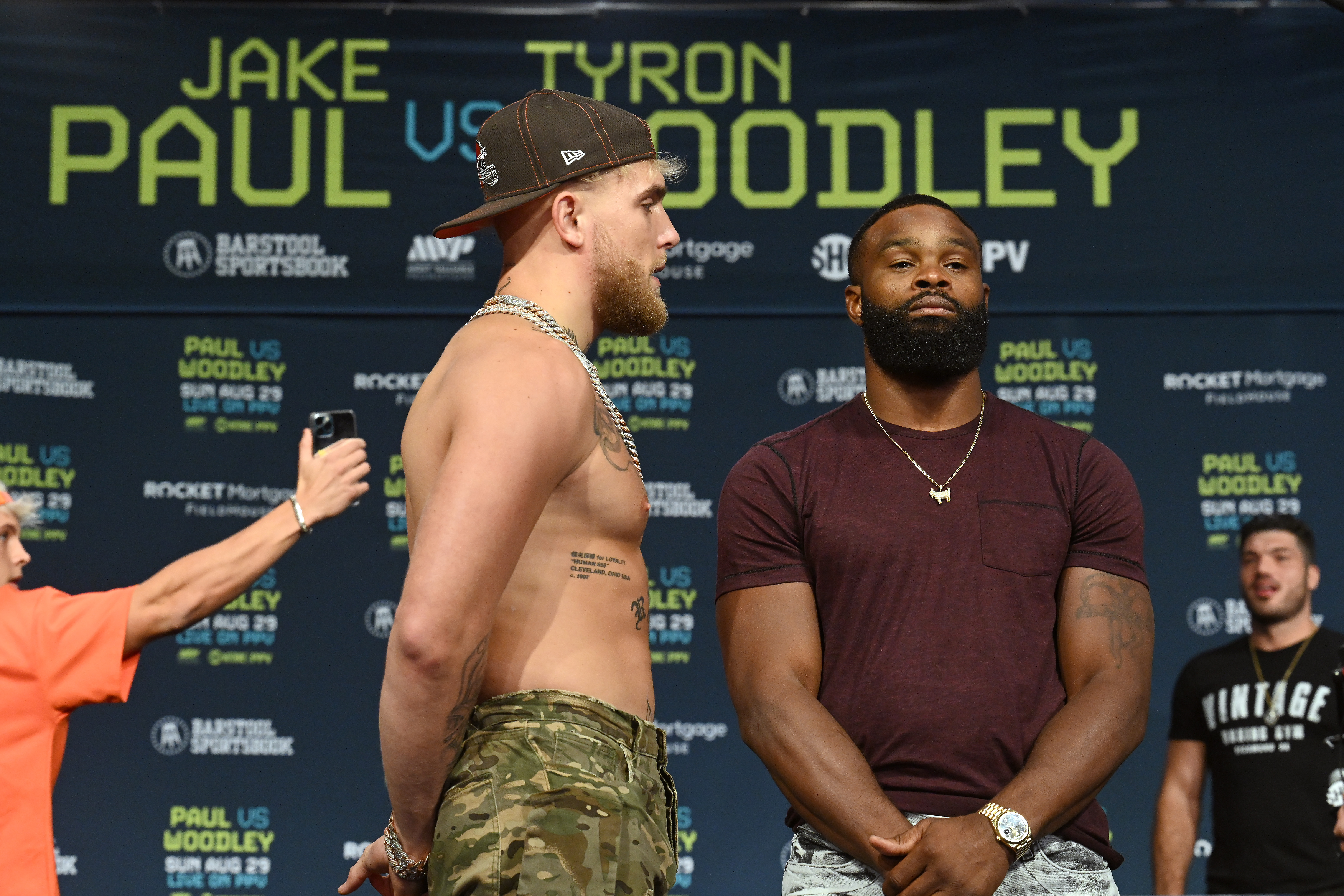 Jake Paul and Tyron Woodley pose during a press conference at the Hilton Cleveland Downtown prior to their August 29 fight on August 26, 2021 in Cleveland, Ohio.