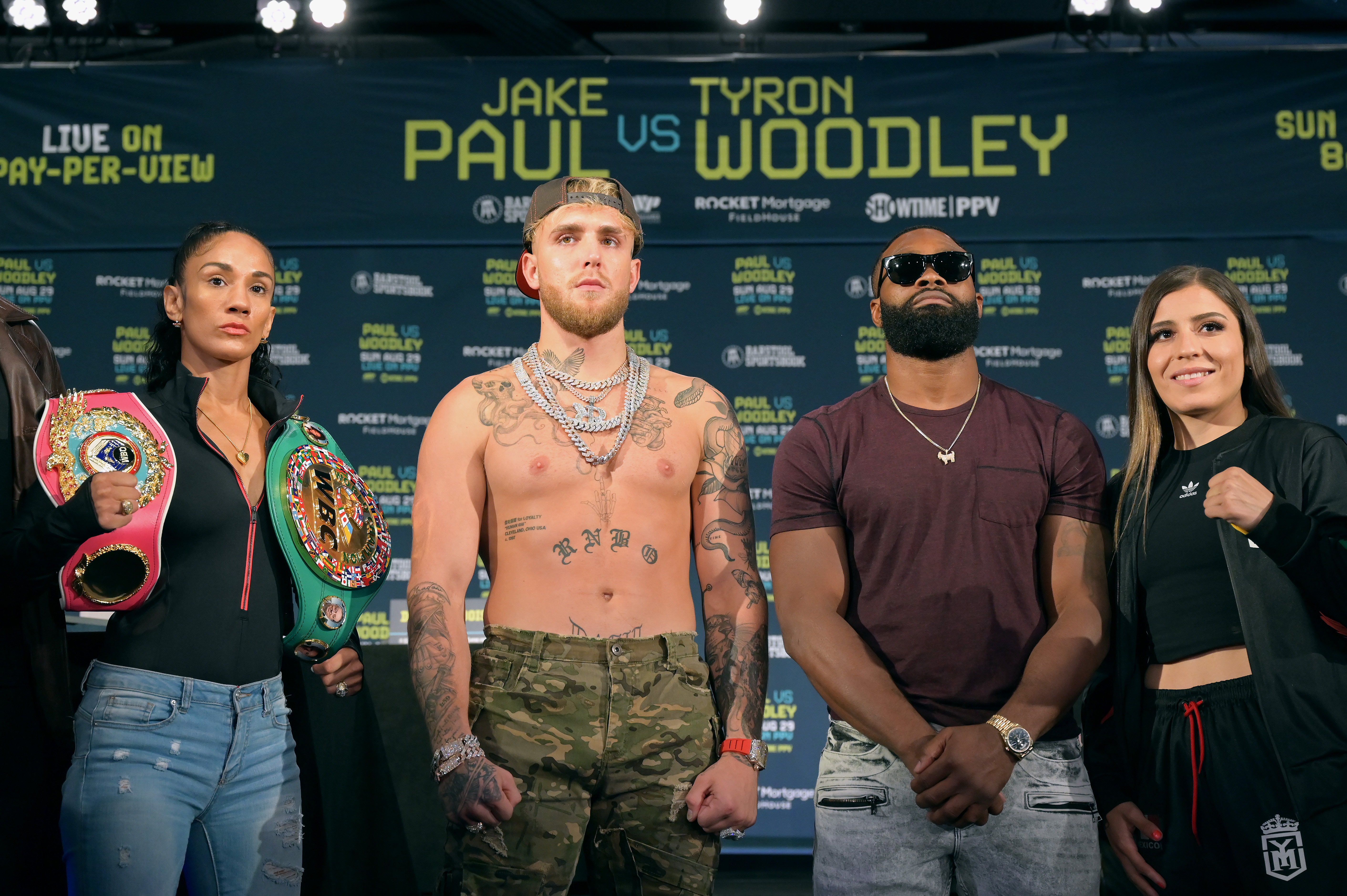 Amanda Serrano, Jake Paul, Tyron Woodley, and Yamileth Mercado (L-R) who are all on the card for the August 29 fight pose for a photo at the Hilton Cleveland Downtown during a press conference on August 26, 2021 in Cleveland, Ohio.