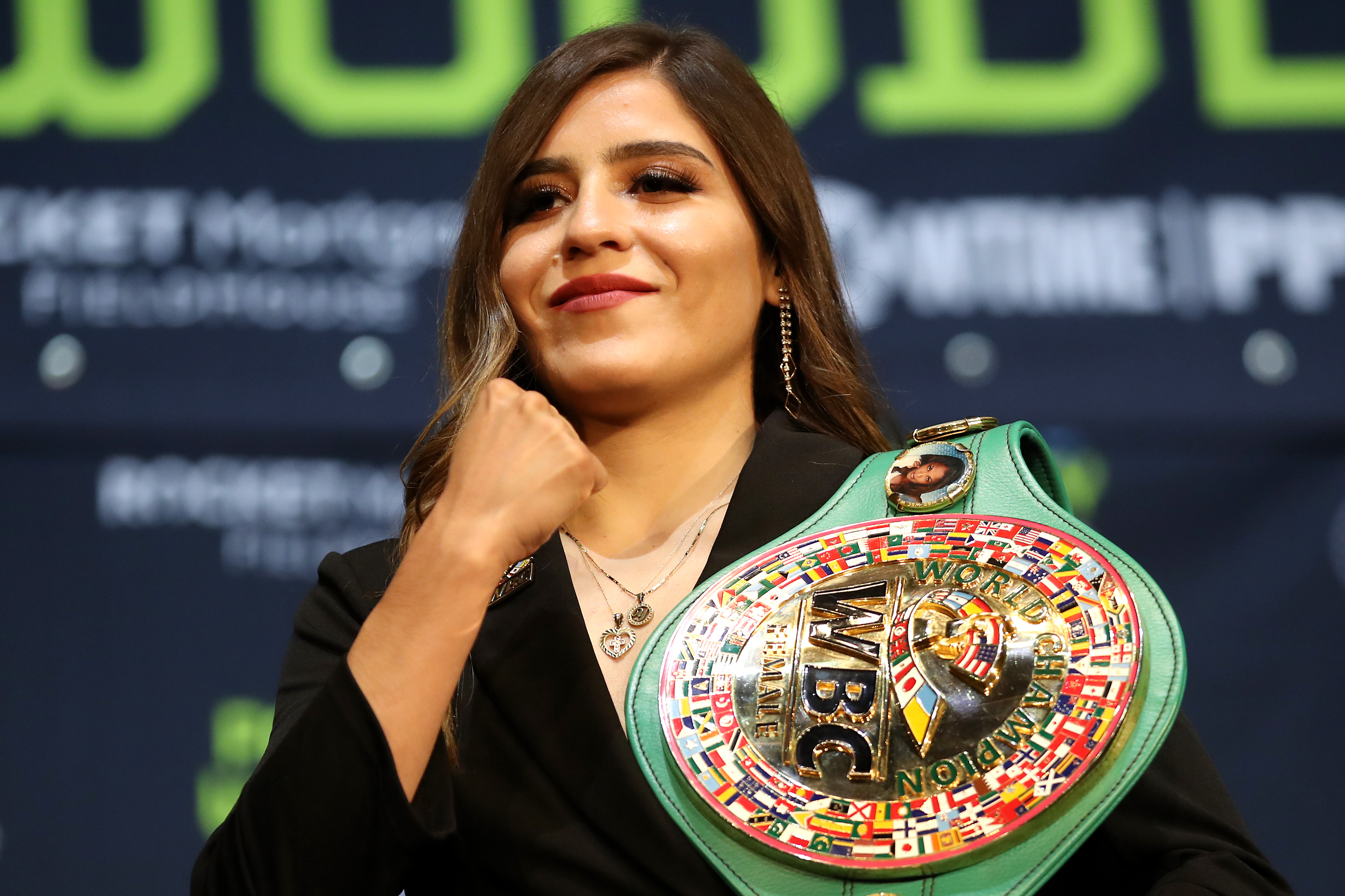 Yamileth Mercado poses for media with her belts during a press conference before her fight against Amanda Serrano at The Novo by Microsoft at L.A. Live on July 13, 2021 in Los Angeles, California.