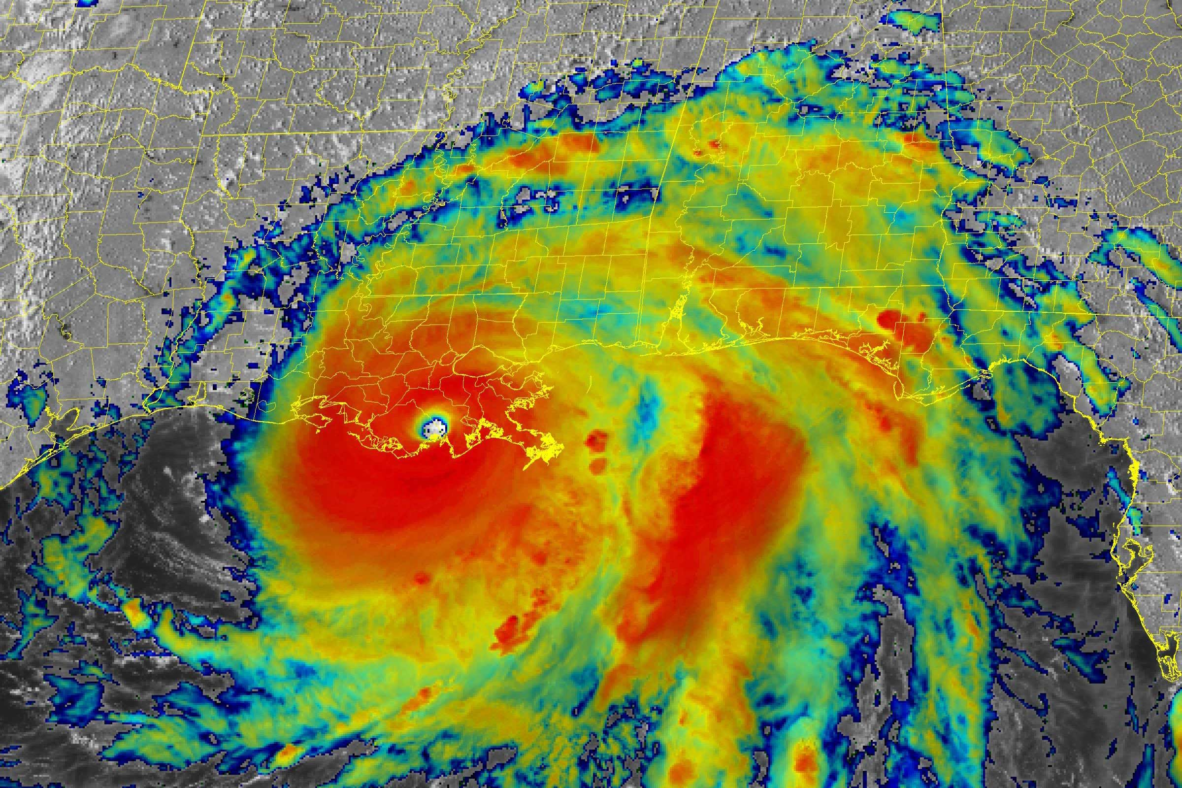 A satellite image of Hurricane Ida showing its spiral shape and using different colors to indicate wind speed.
