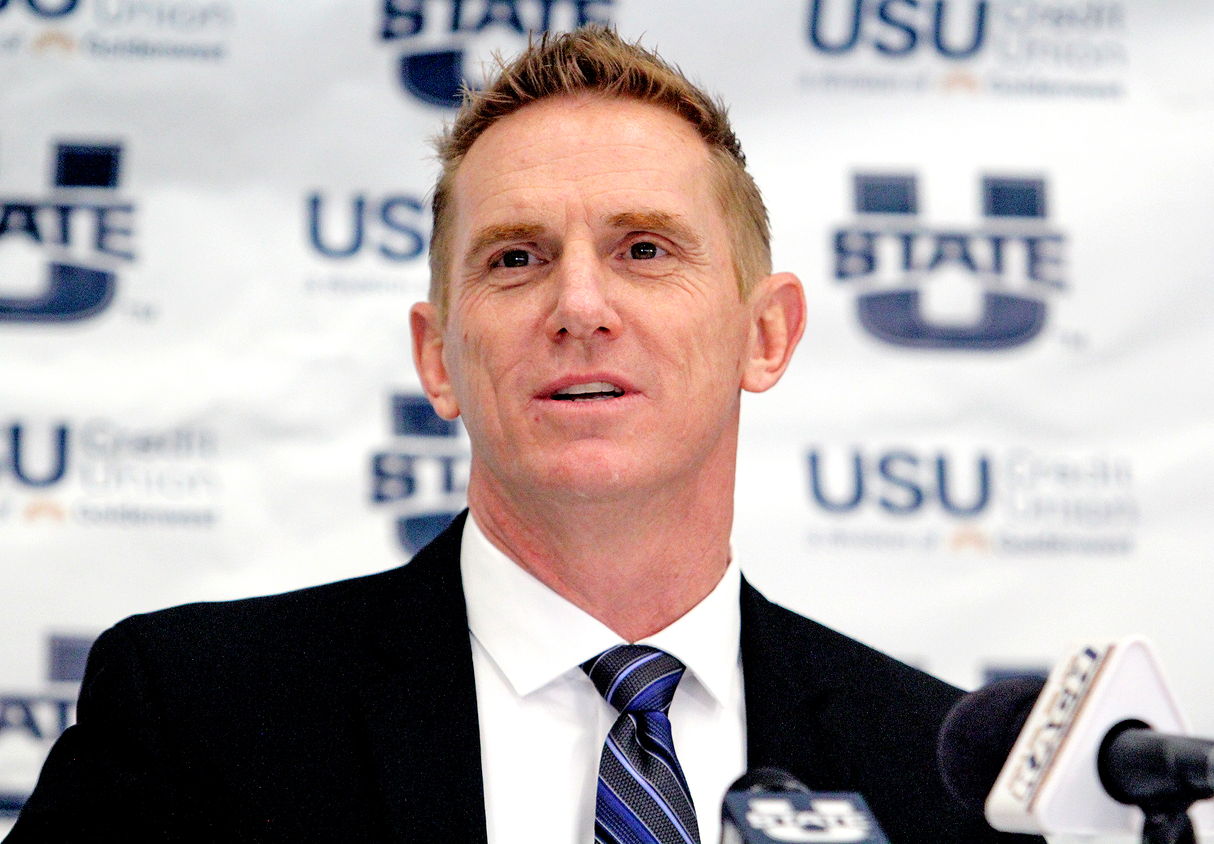 New Utah State football coach Blake Anderson answers questions at a press conference at Maverik Stadium in Logan.