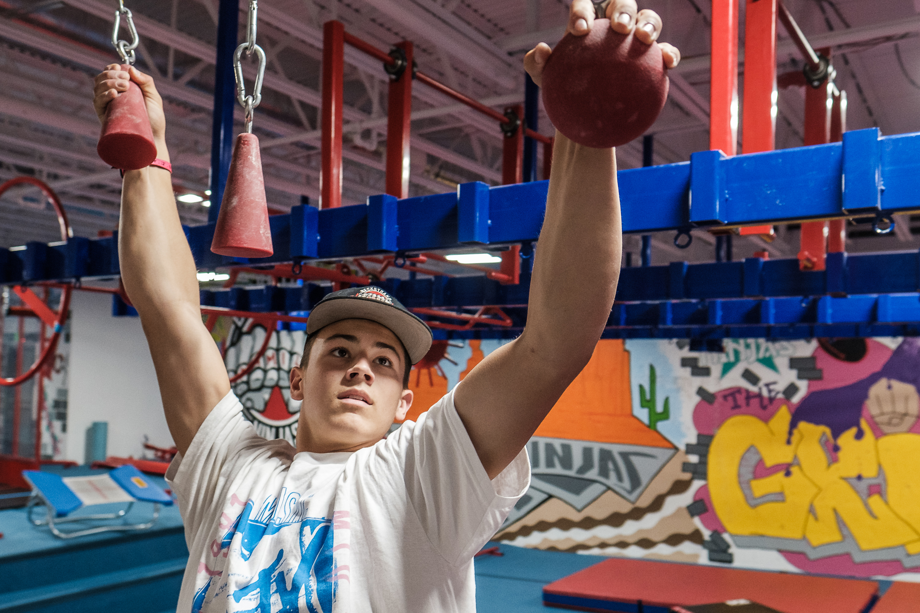 Kai Beckstrand demonstrates parts of his training regimen at his family's gym in St. George on Saturday, August 28, 2021. Beckstrand's efforts landed the 15-year-old in the finals of the competition television show American Ninja Warrior.