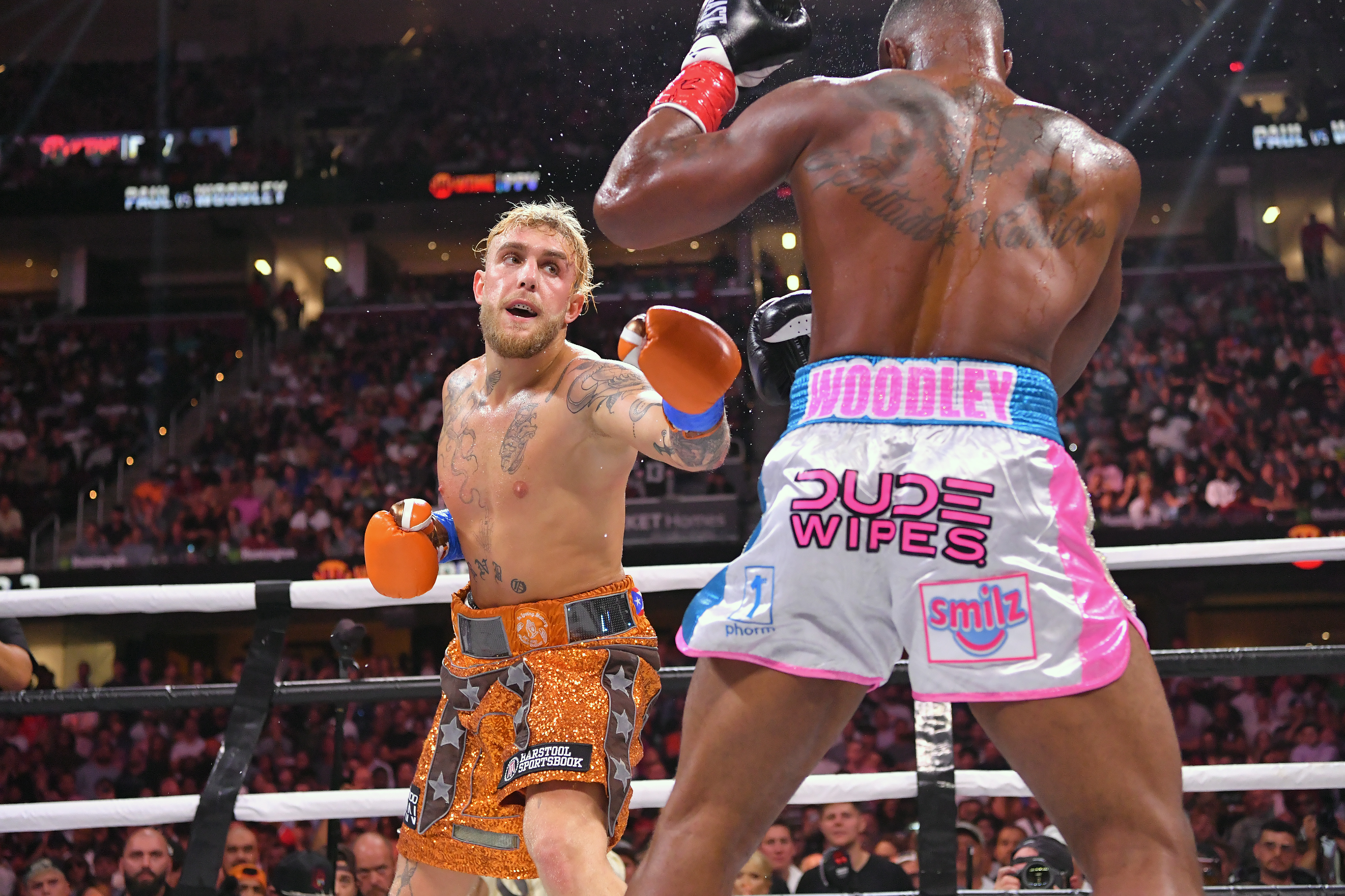 Jake Paul keeps an undefeated record with a split decision win over former UFC champion Tyron Woodley.