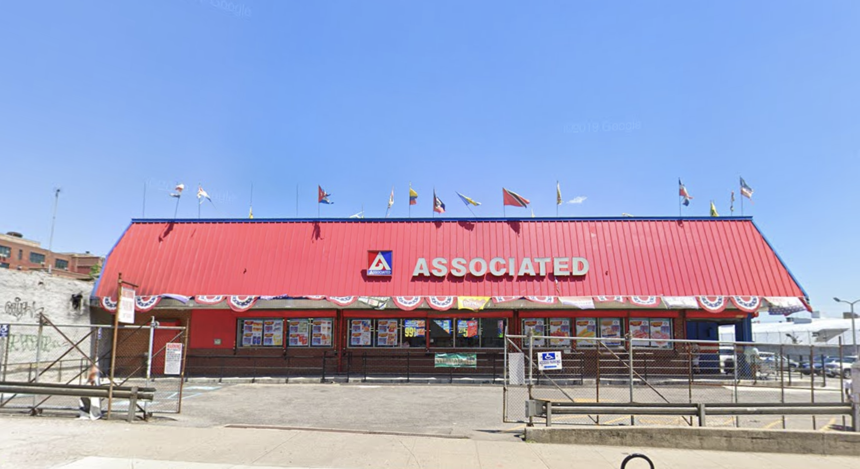 The exterior of the Nostrand Avenue Associated supermarket, which has a red roof